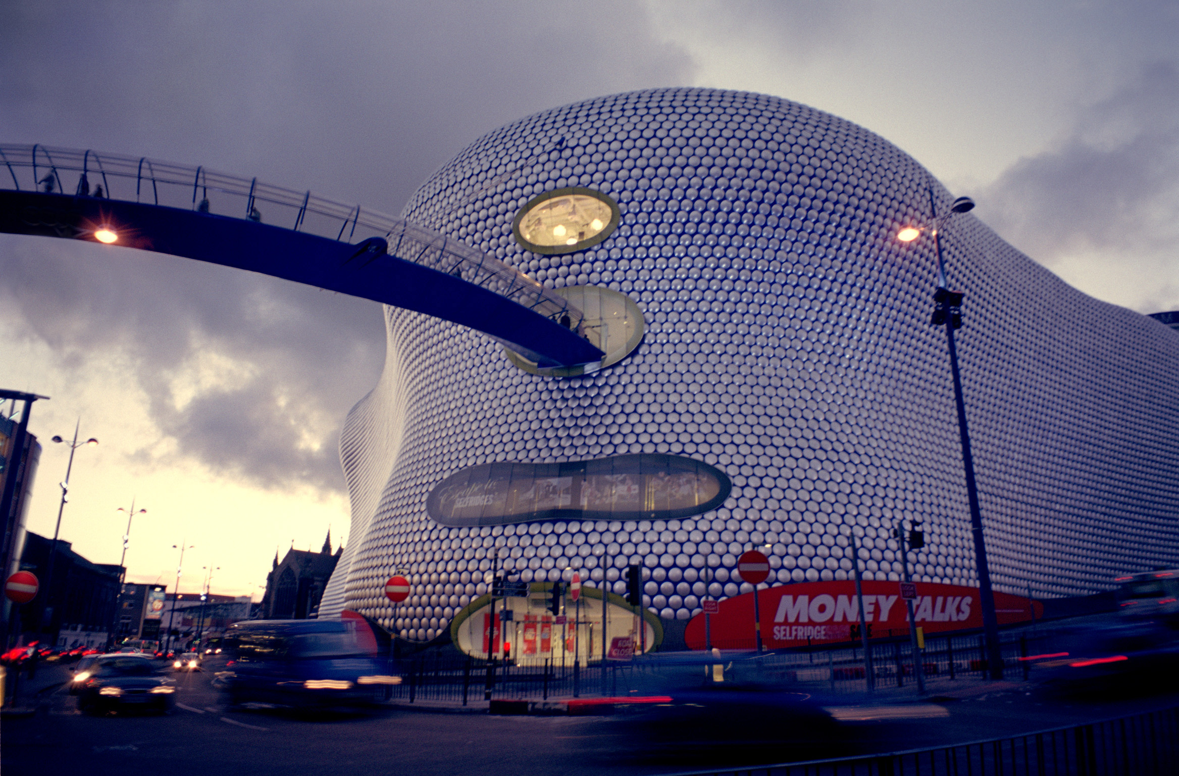 Street Scene Along Famous Bullring Shopping Center, Located at Birmingham, England During Night Time.