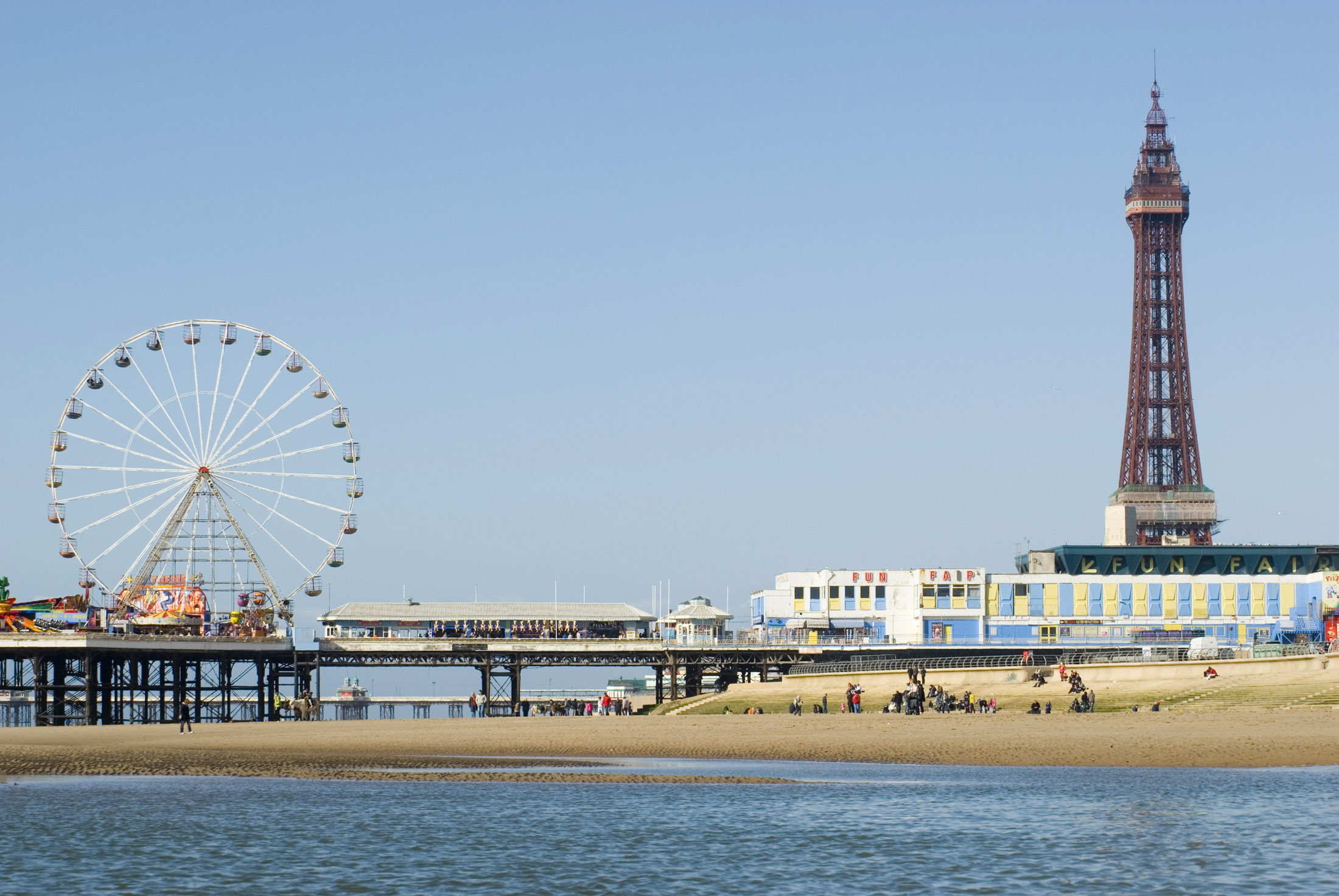a view of blackpools central pier and the iconic tower