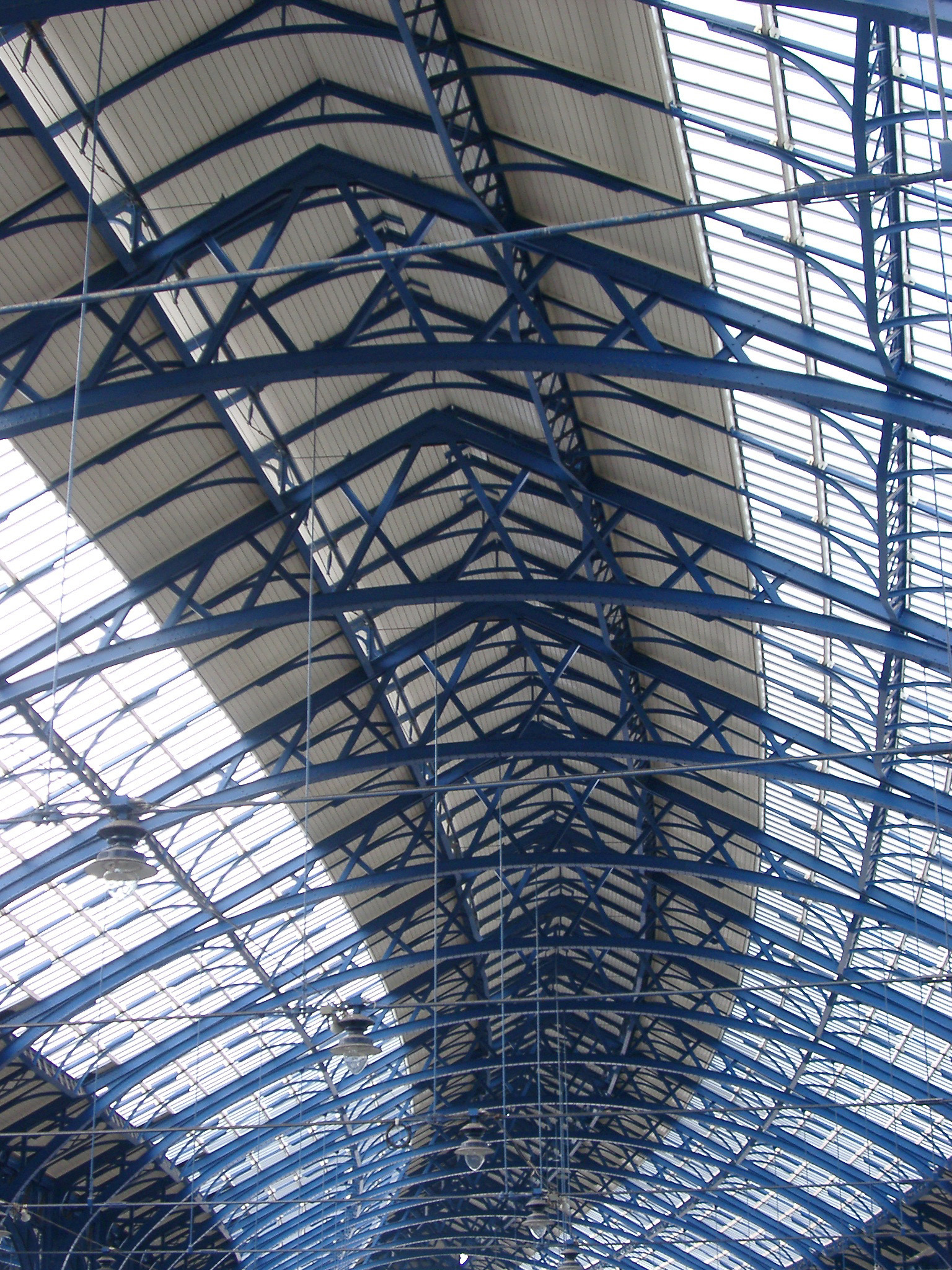 Looking Up at Blue Girder and Glass Ceiling in Brighton Railway Station, Brighton, England