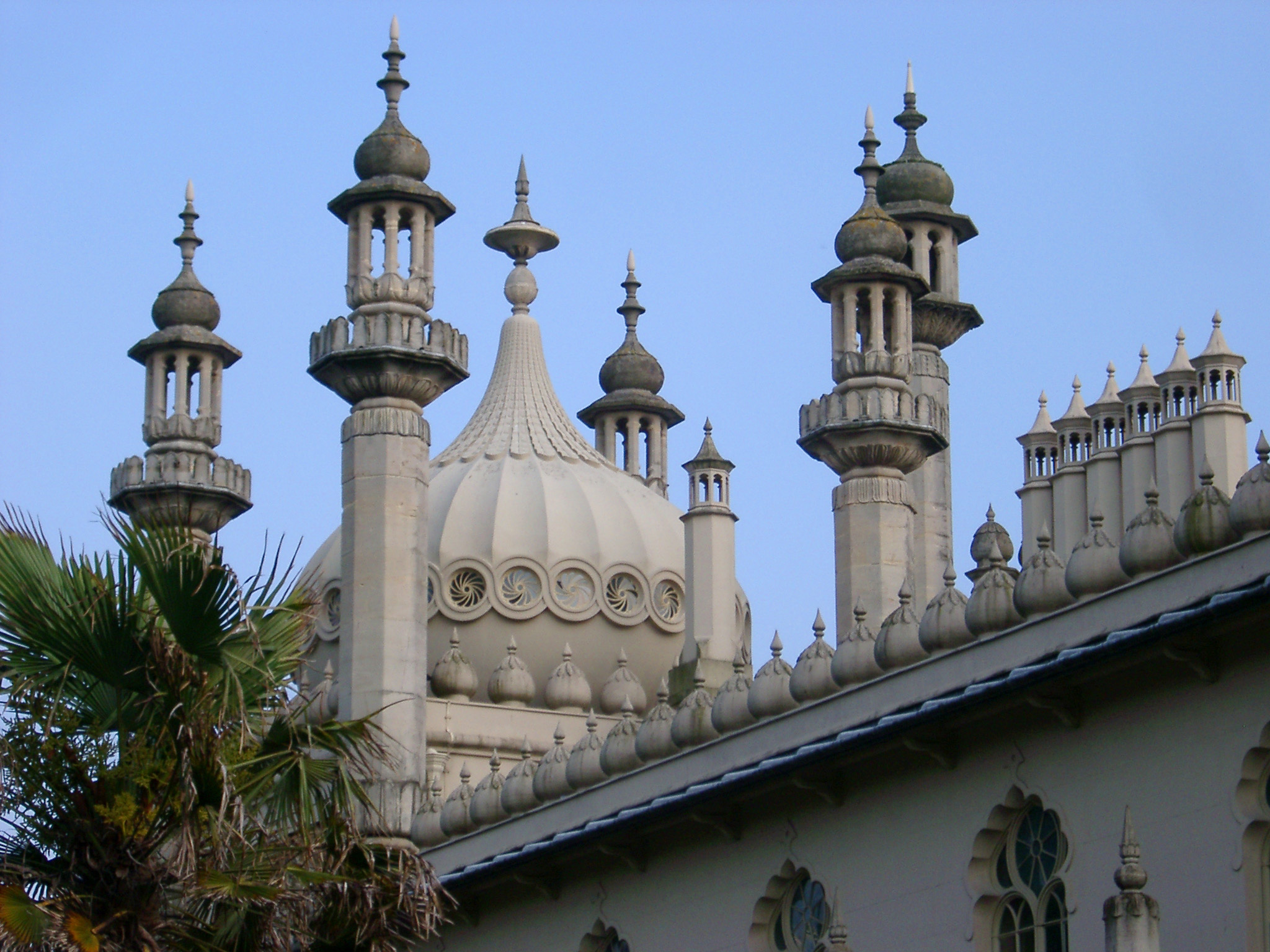Famous Architectural Exterior Design, Emphasizing Dome, of Royal Pavilion Building in Brighton, England, United Kingdom. Captured on the Afternoon with Light Blue Sky Background.