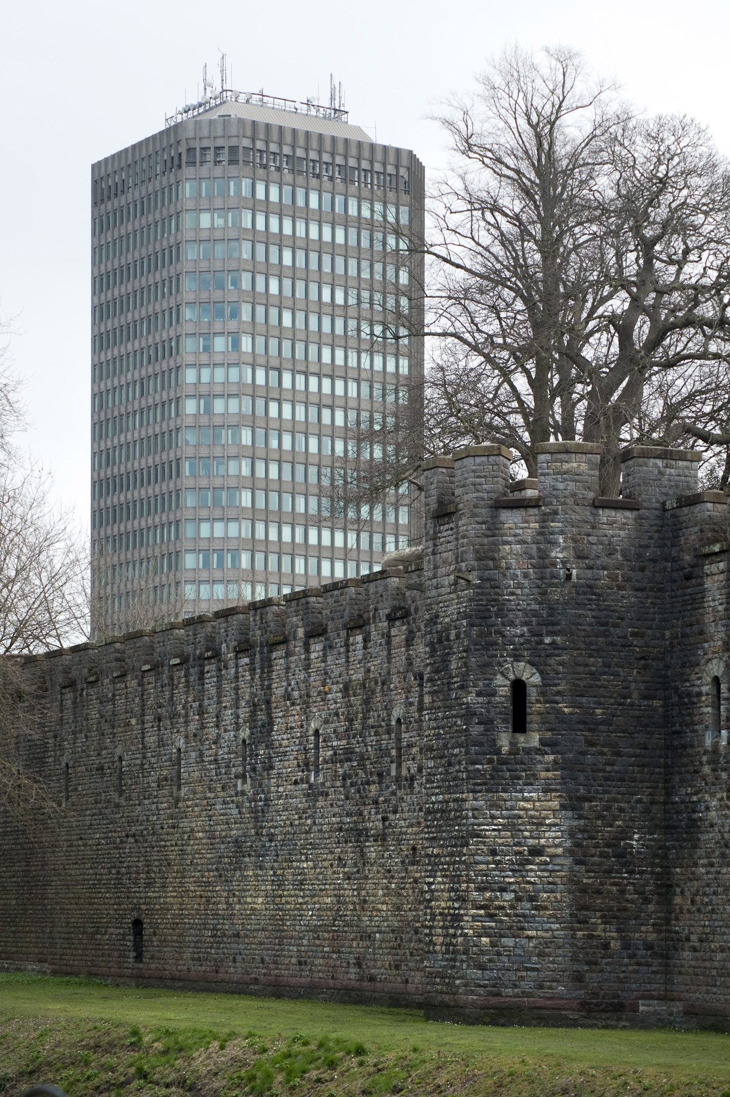old and modern cardiff, the castle walls and an office block