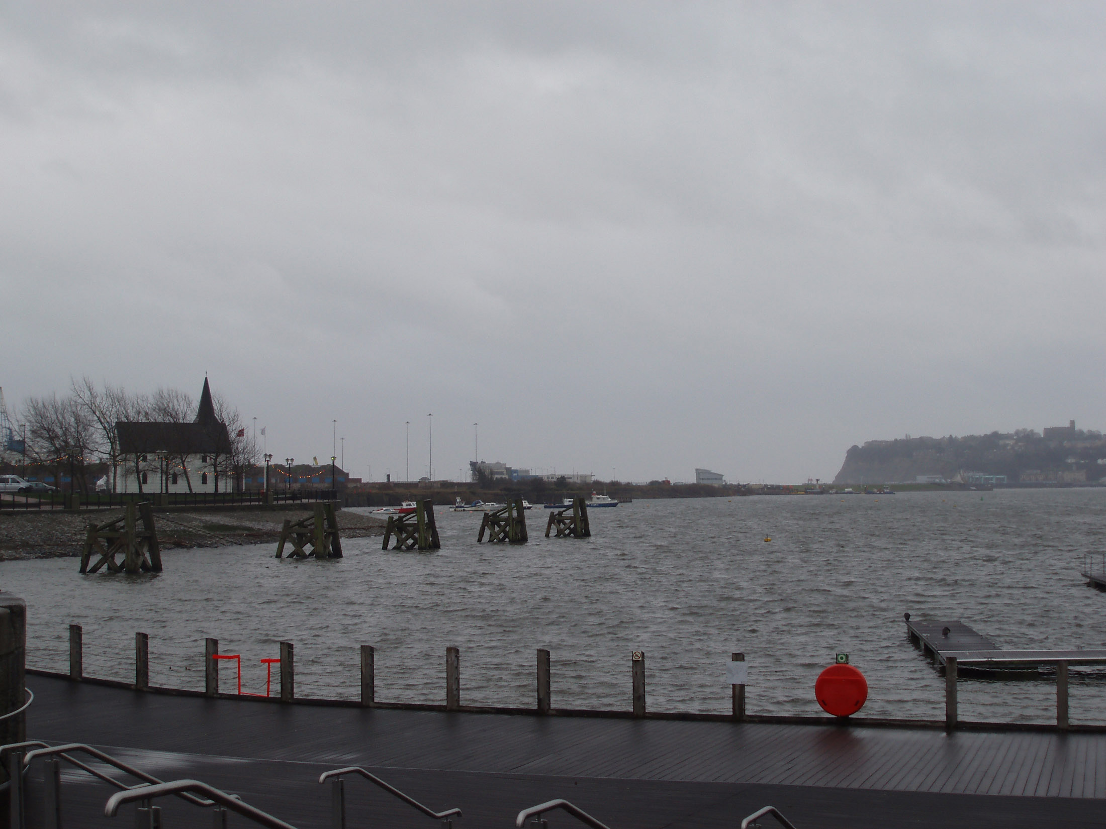Famous Cardiff Bay - the area created by the Cardiff Barrage in South Cardiff, Wales. Captured with Gray Sky Above.
