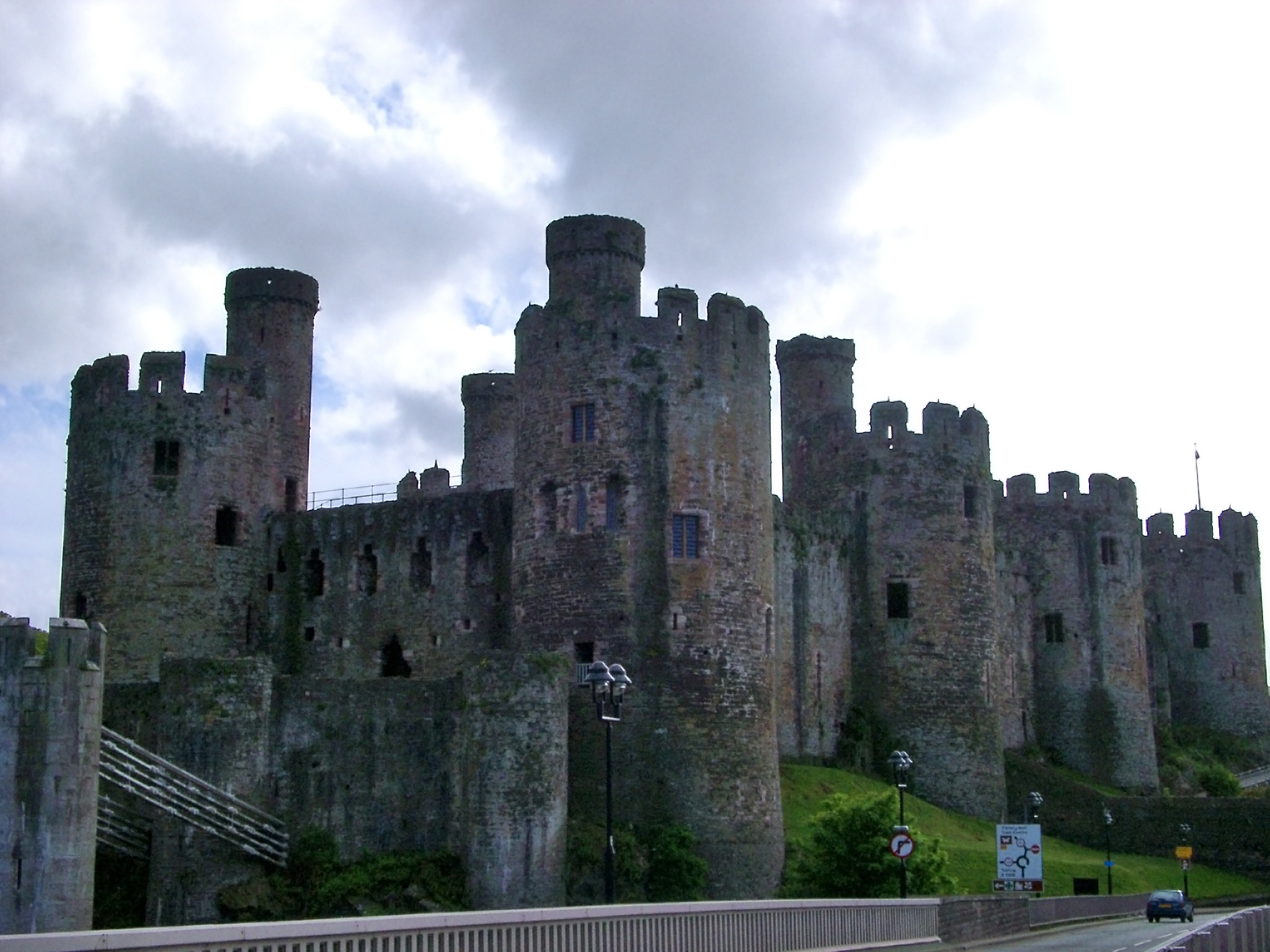 Conwy Castle - Famous Ancient Landmark of Conway, Wales on a Grassy Landscape.