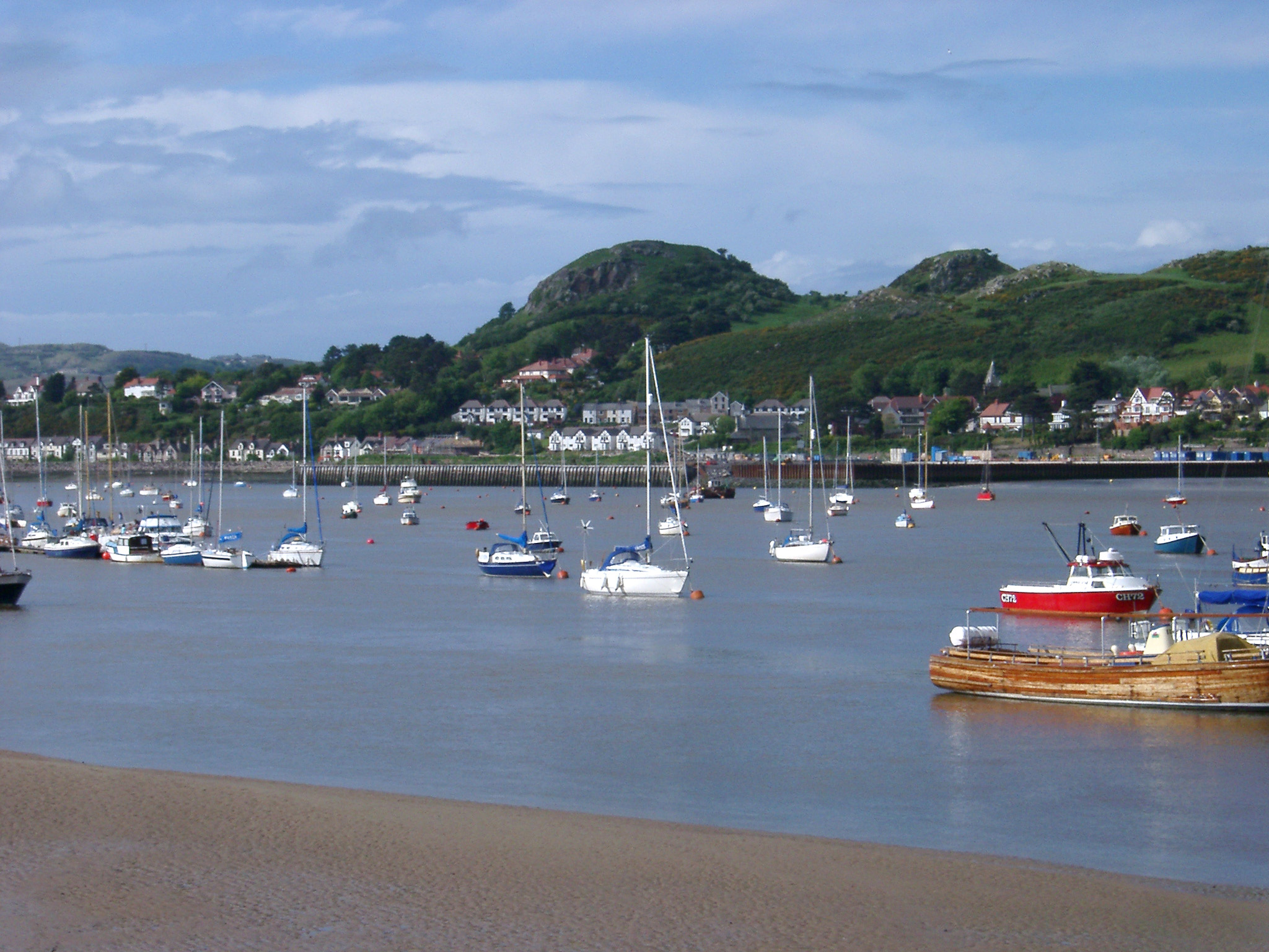 Various Small Boats at Famous Conwy River in Wales. Captured with Hills Afar.