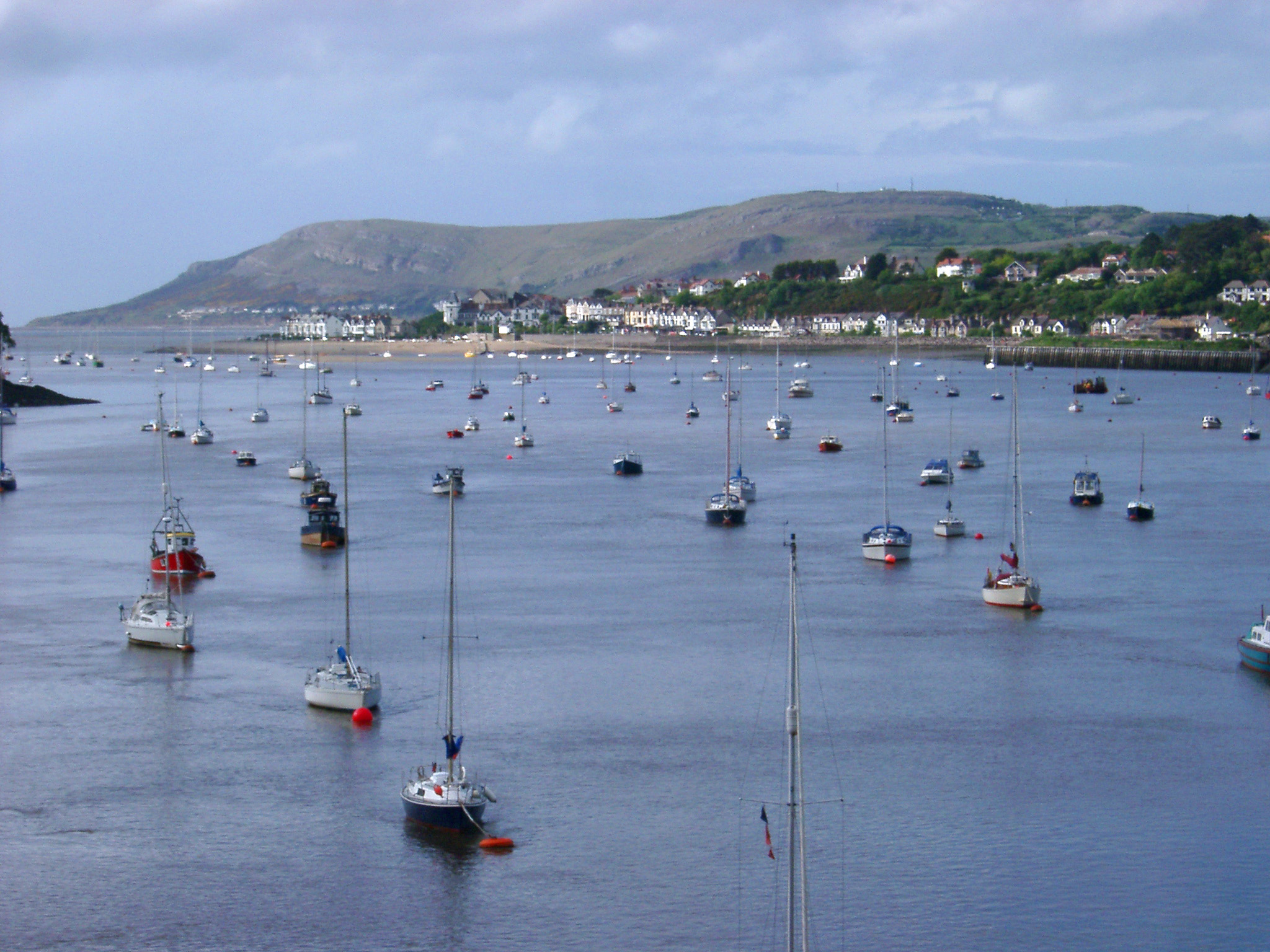 Various Small Boats at Anchor at Famous River Conwy, Wales. Captured with Mountains View Afar.