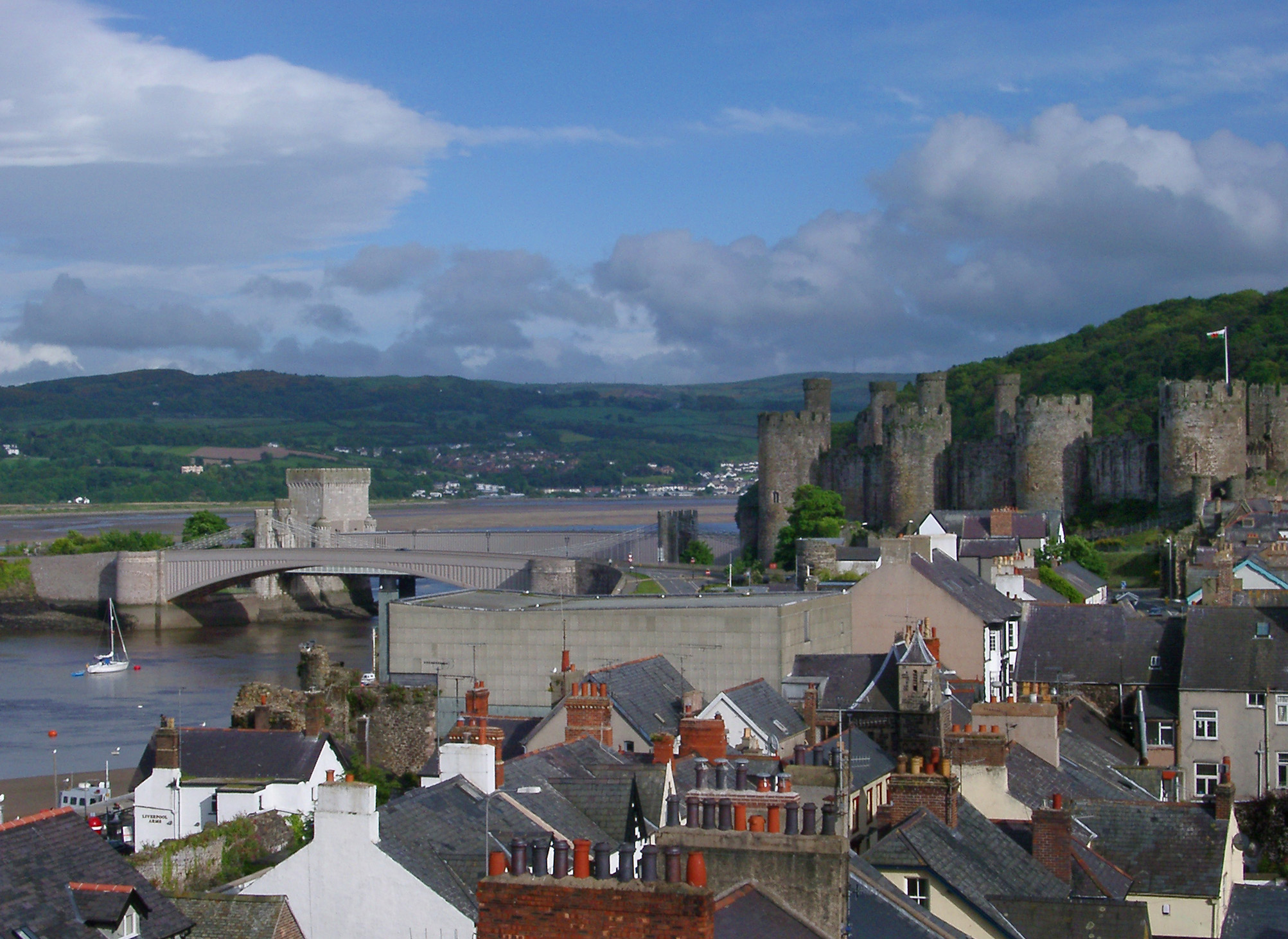 Panorama View of Various Building Rooftops and Ancient Medieval Castle at Conwy, Wales.