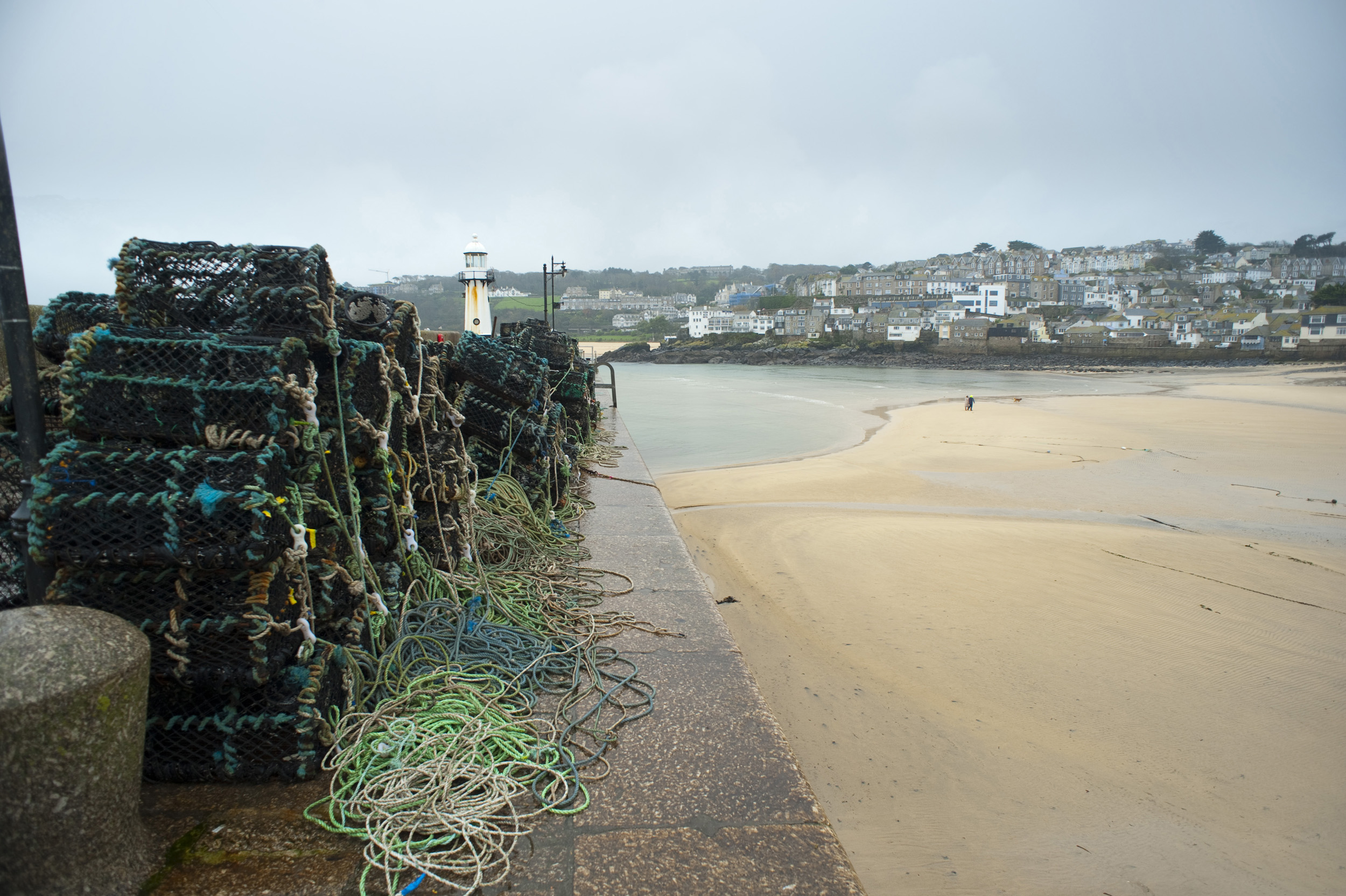 Crab or Lobster traps piled up on the quayside at Saint Ives harbour, Cornwall, UK