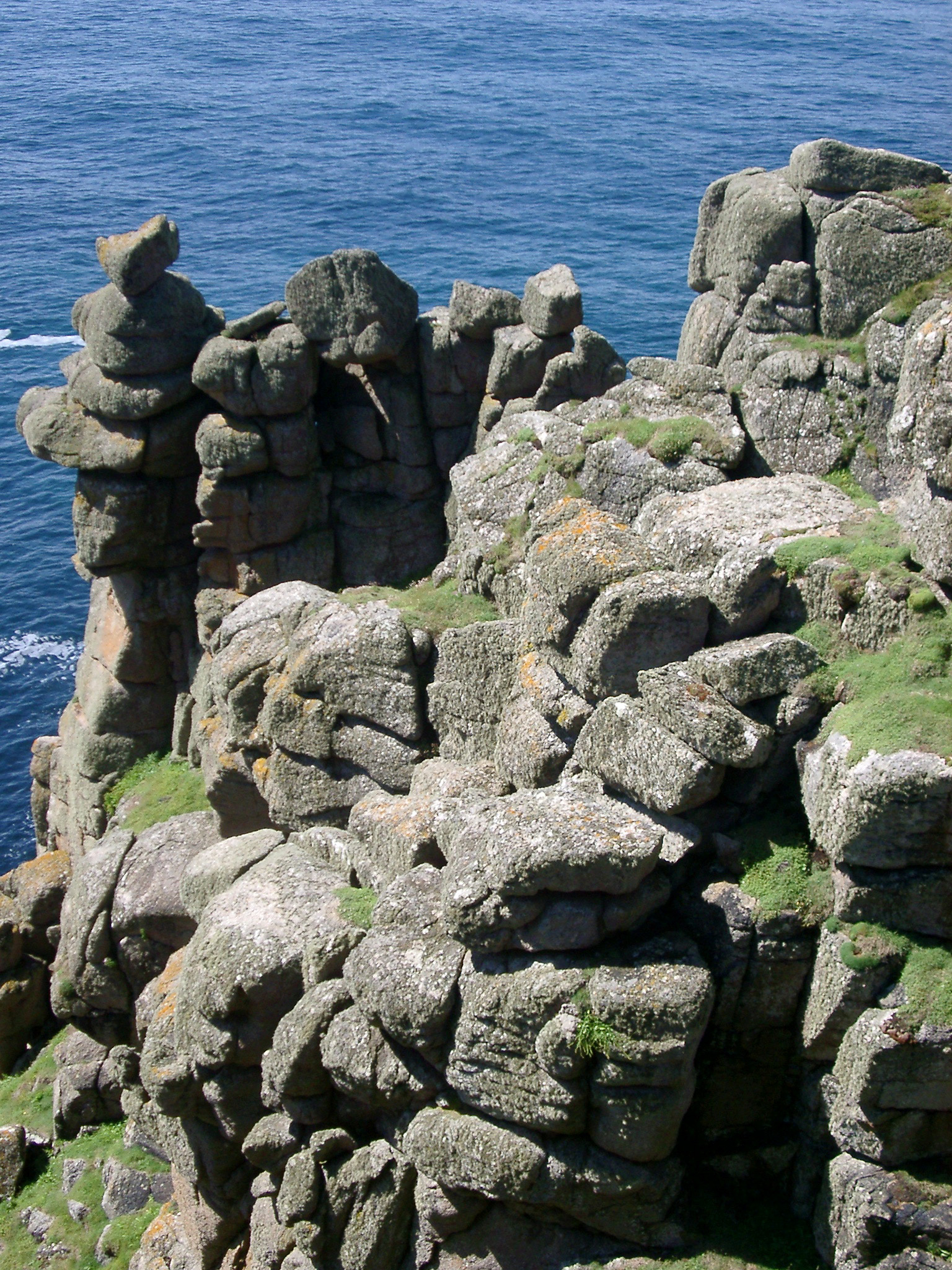 erroded rock formations weathered by countless storms over the headland and lands end, cornwall