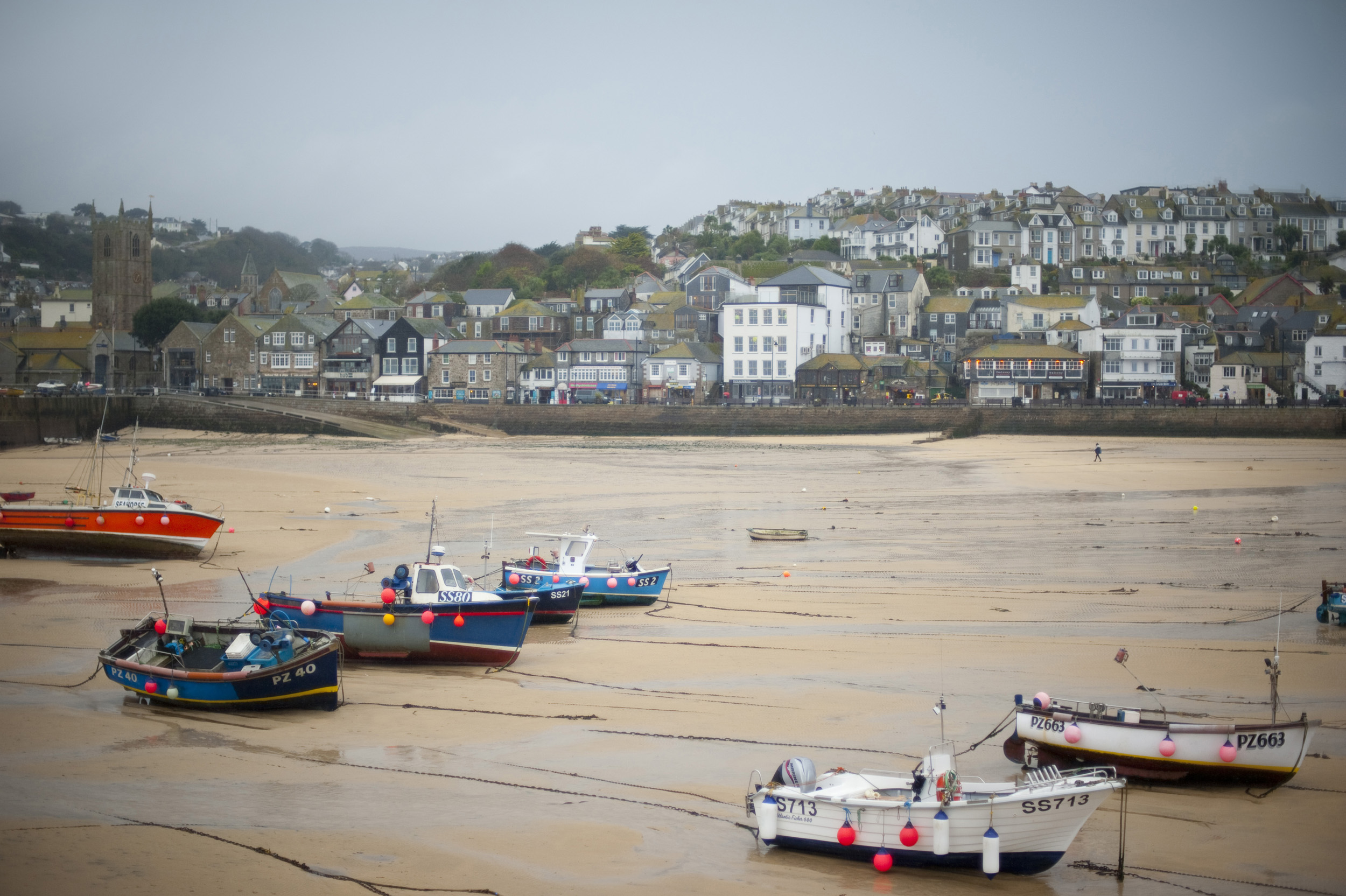 fishing boats at low tide in the harbour at saint ives, cornwall