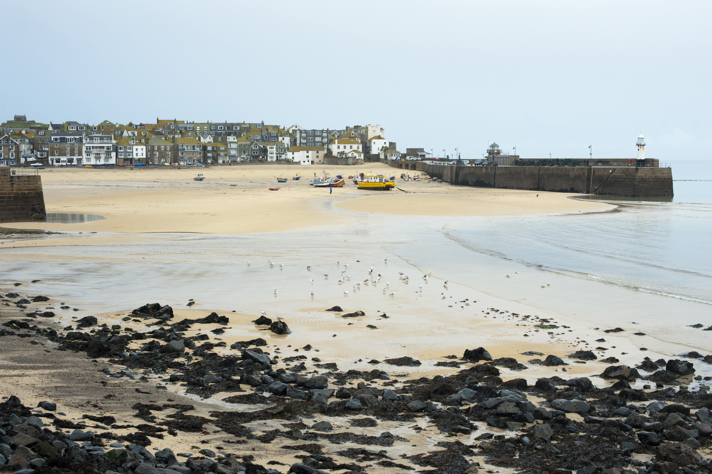 low tide in the harbour at saint ives, cornwall