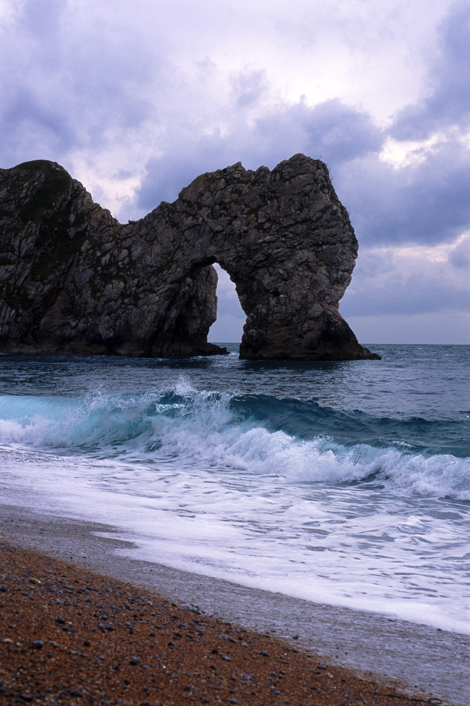The famous Durdle Door stone arch eroded by the sea from the Jurassic coastline, dorset