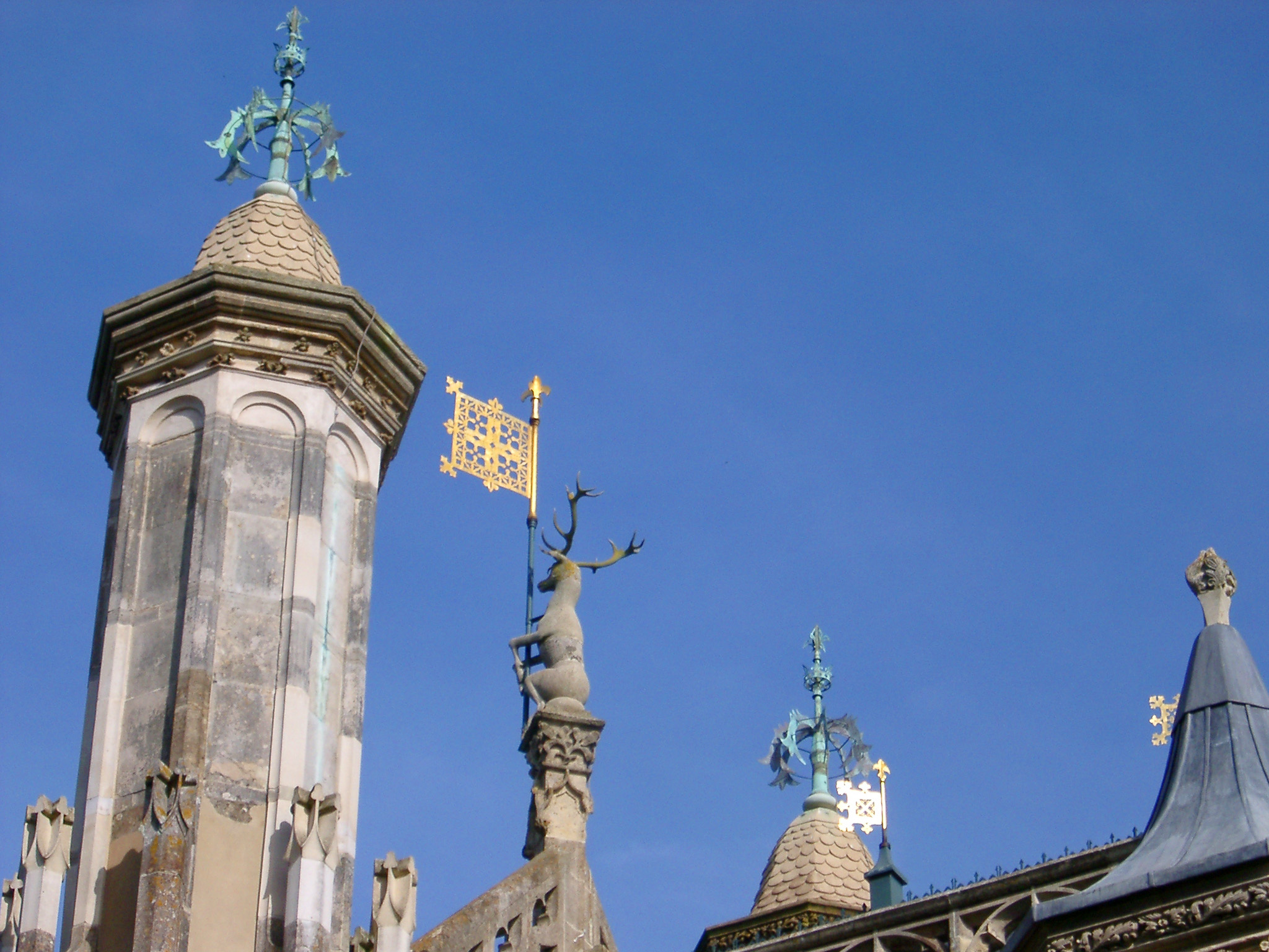 gothic revival roof decorations pictured against a blue sky