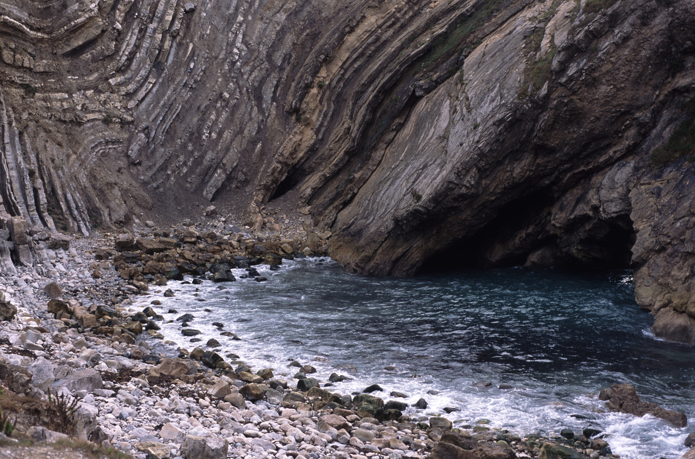 crumpled rock strata, stair hole, lulworth, dorset