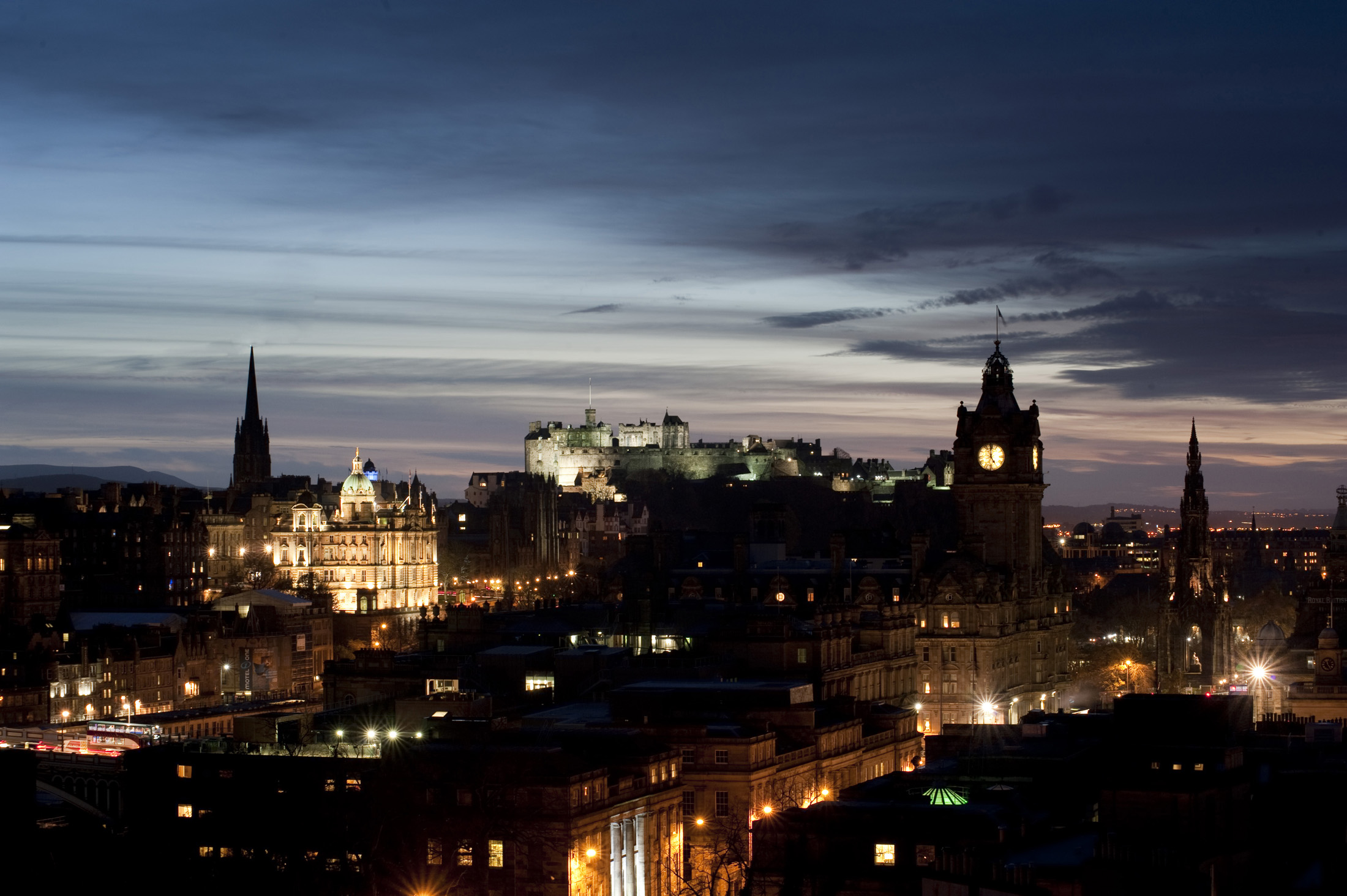 Silhouetted and floodlight shapes of the edinburgh skyline looking towards the castle from carlton hill