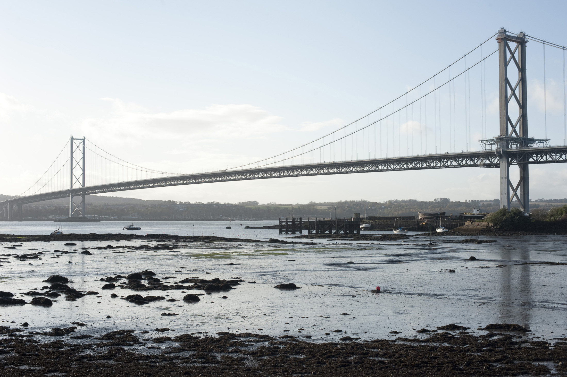 a view of the forth road bridge from north queensferry, scotland