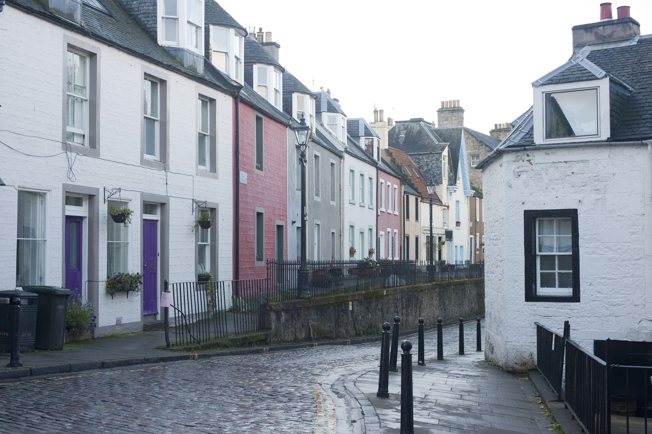 small terraced houses and coble stone streets in queensferry, scotland