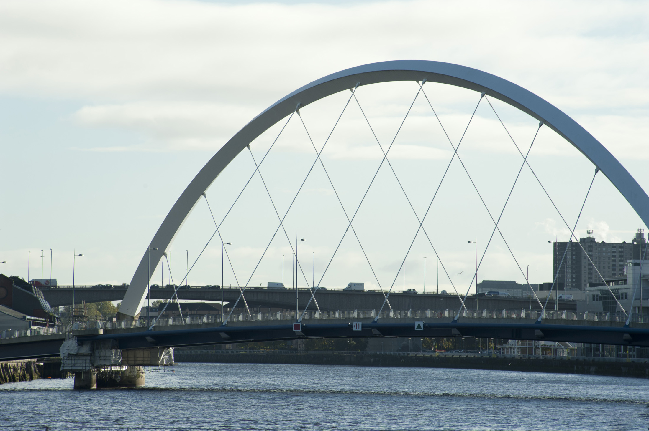 The Clyde Arc in Glagsow, Scotland, a modern road bridge spanning the River Clyde with a steel arc above the span
