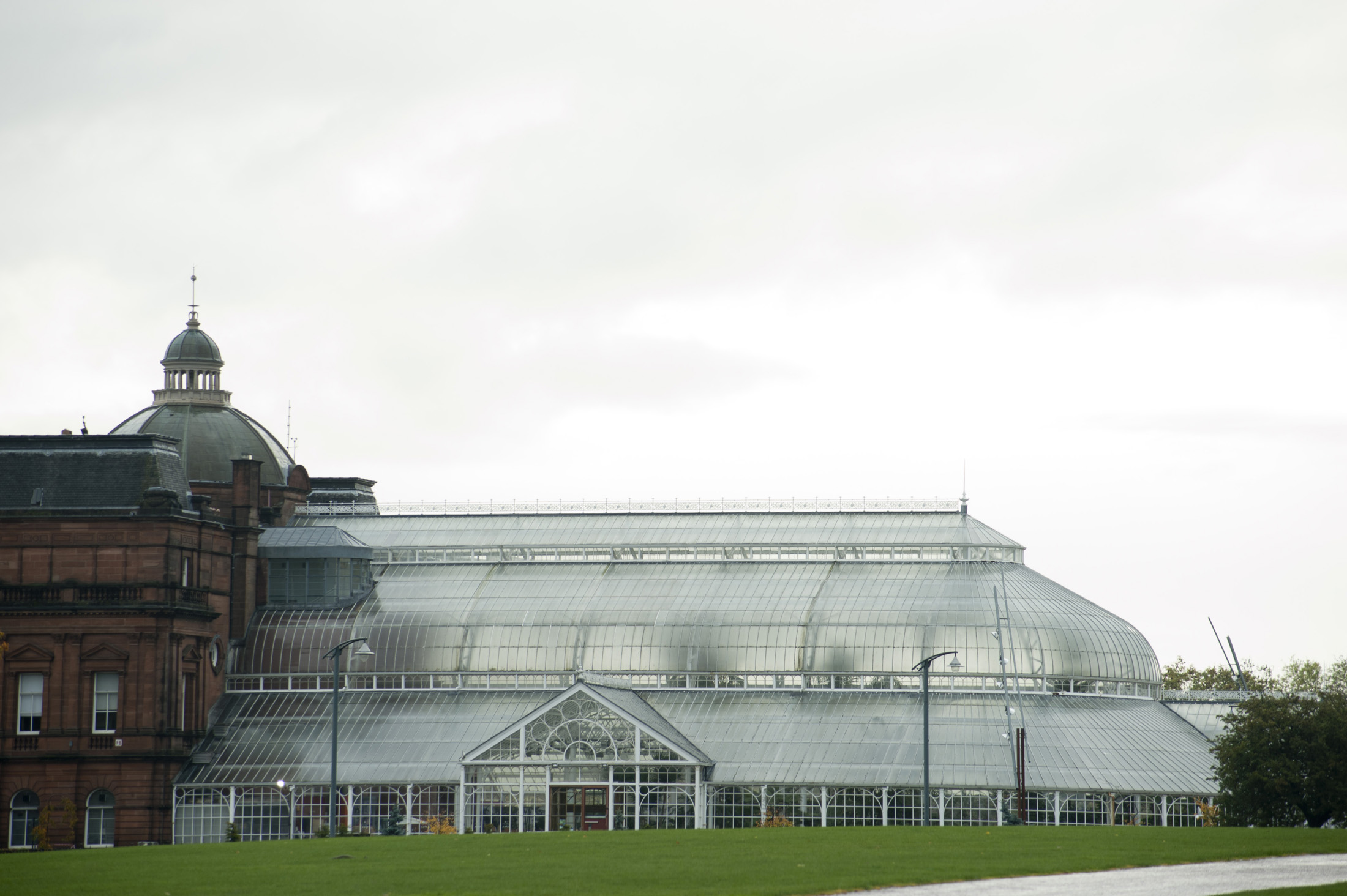 Scenic view of the exterior of the People Palace Winter Garden in Glasgow, a large historical Victorian glasshouse which now houses a museum