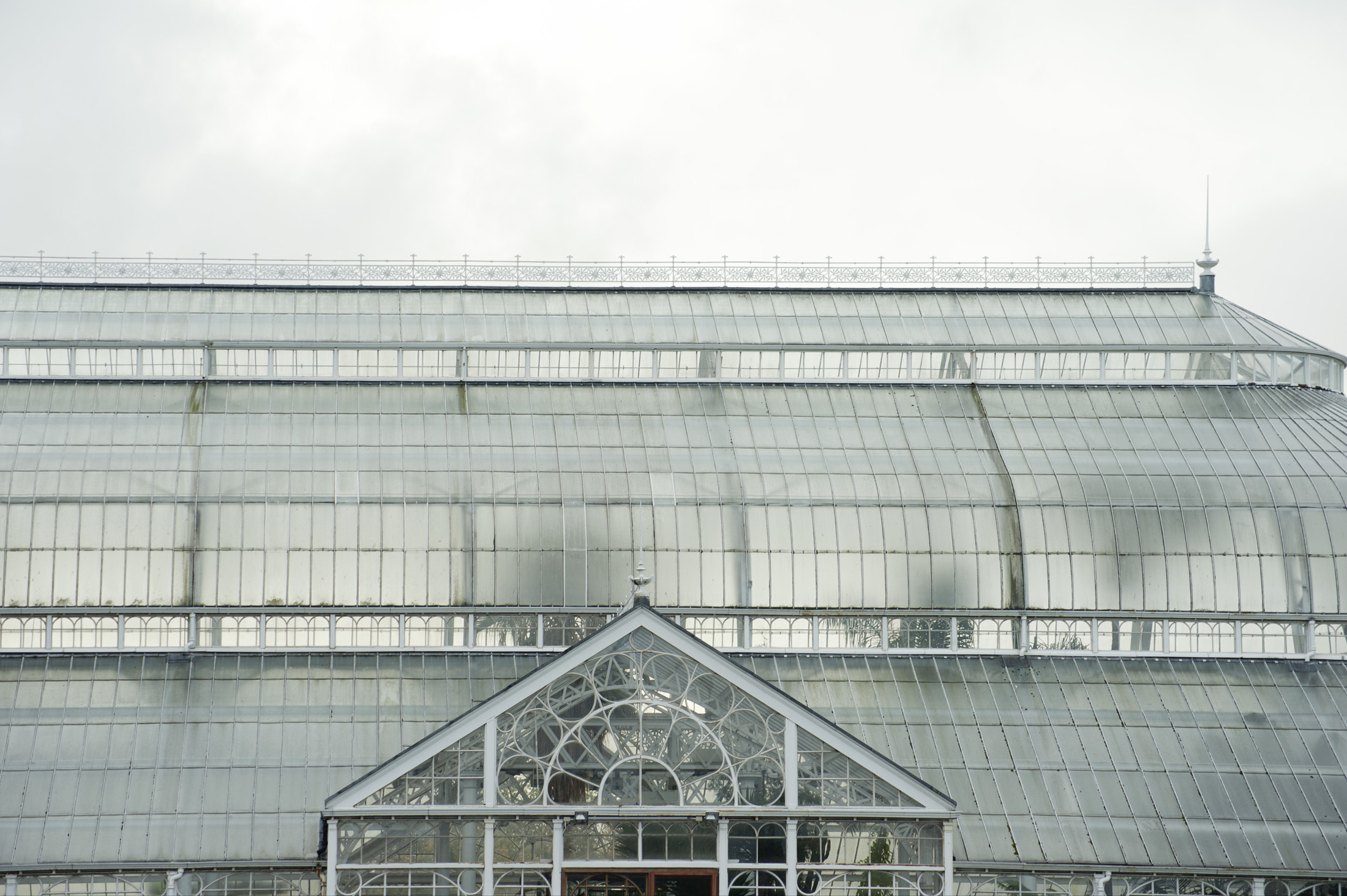 View of the domed roof and exterior facade of the People Palace Winter Gardens in Glasgow, Scotland, a huge Victorian glasshouse which now houses a museum and exhibitions