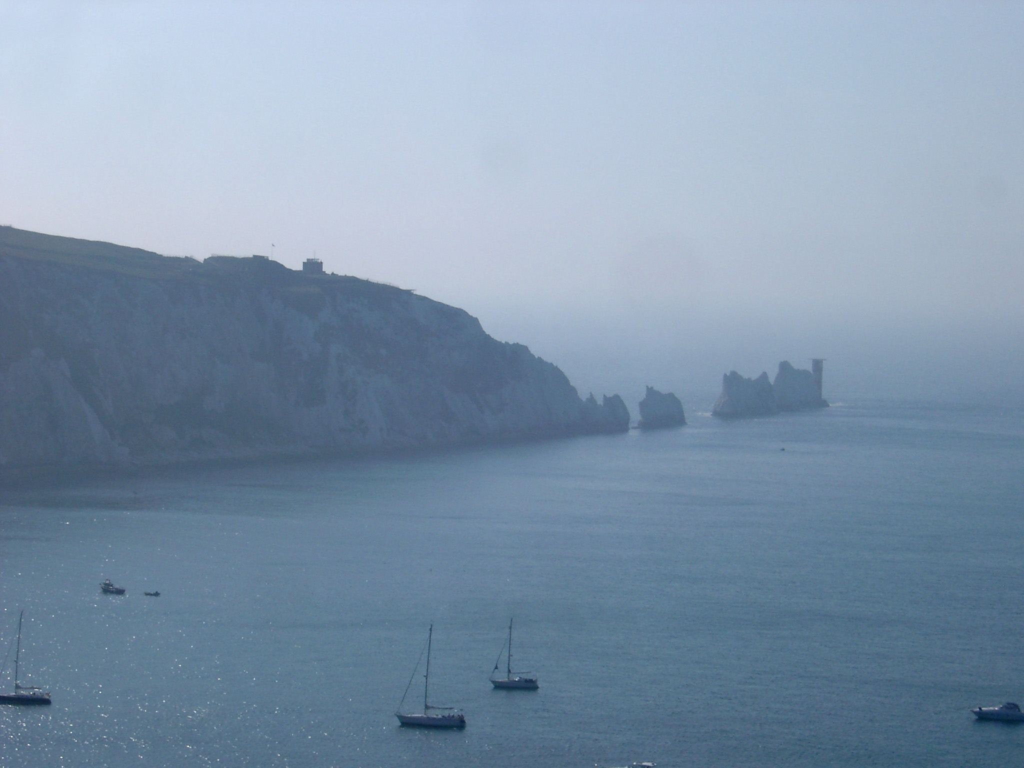 The Needles, Isle of White, a line of chalk stacks rising from the ocean just offshore from the headland