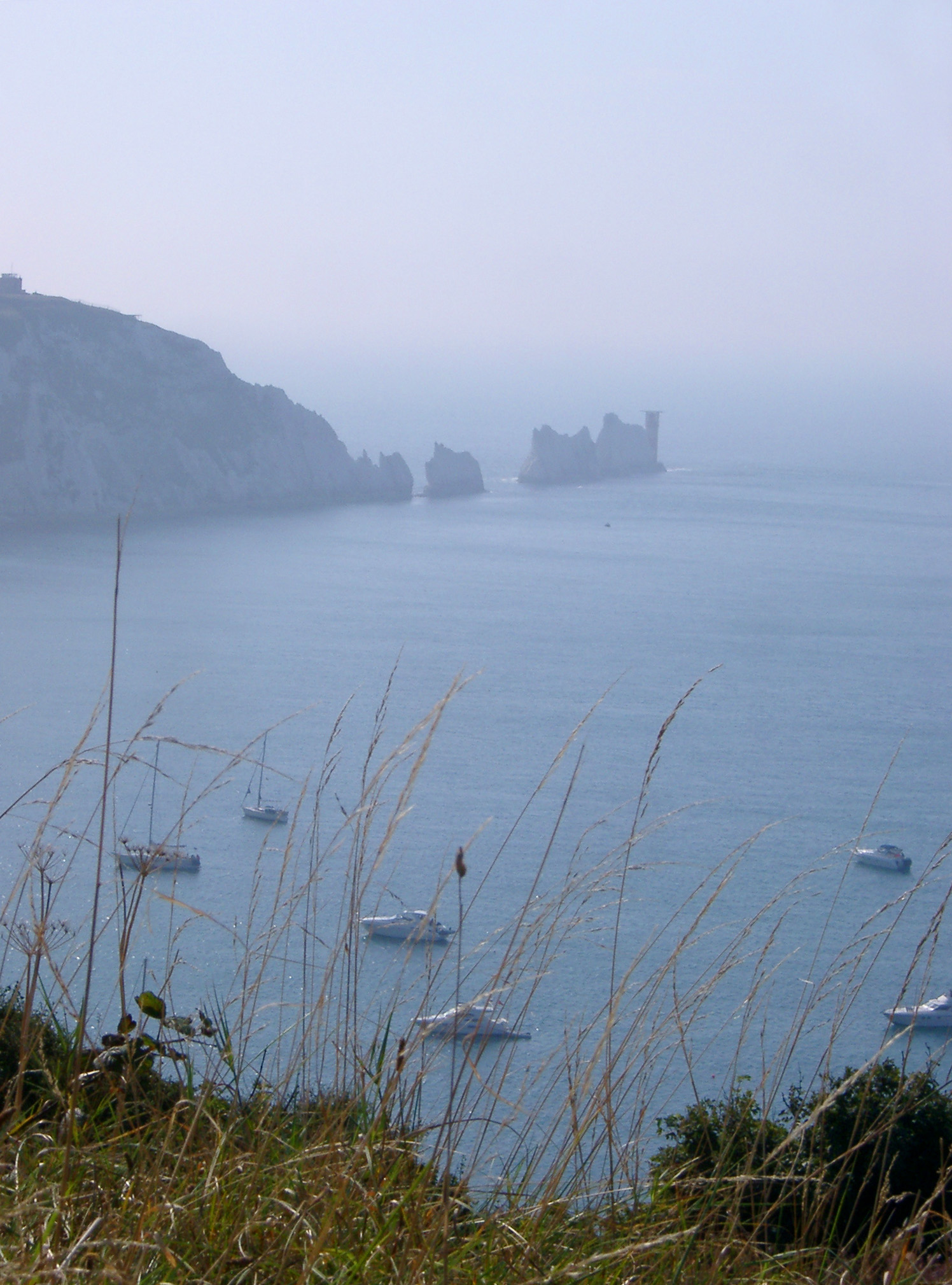 View of the Needles, Isle of Wight, a row of eroded chalk stacks rising out of the ocean