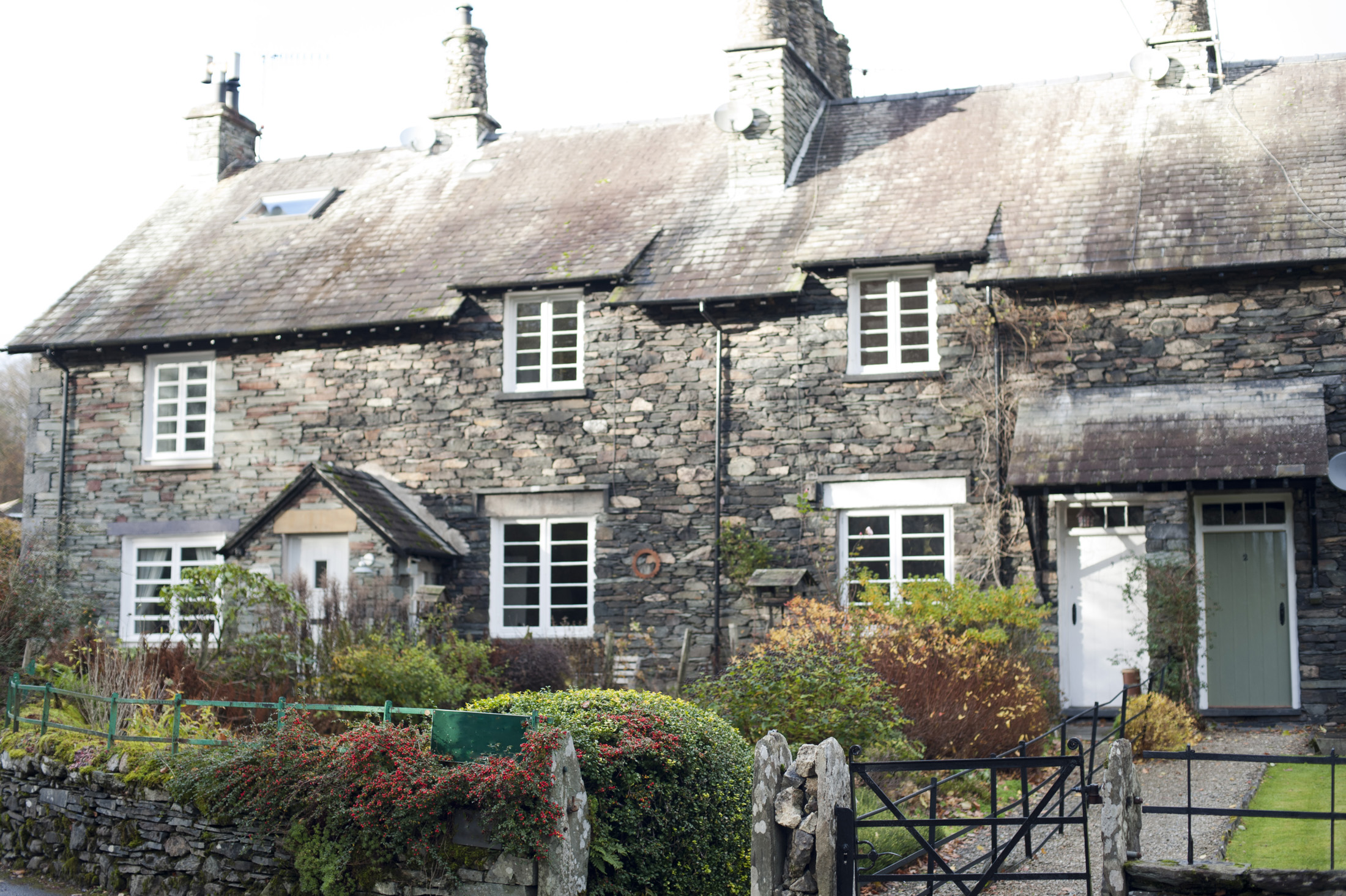 Row of old quaint stone cottages at Skelwith Bridge in the Lake District in Cumbria, an area popular with tourists
