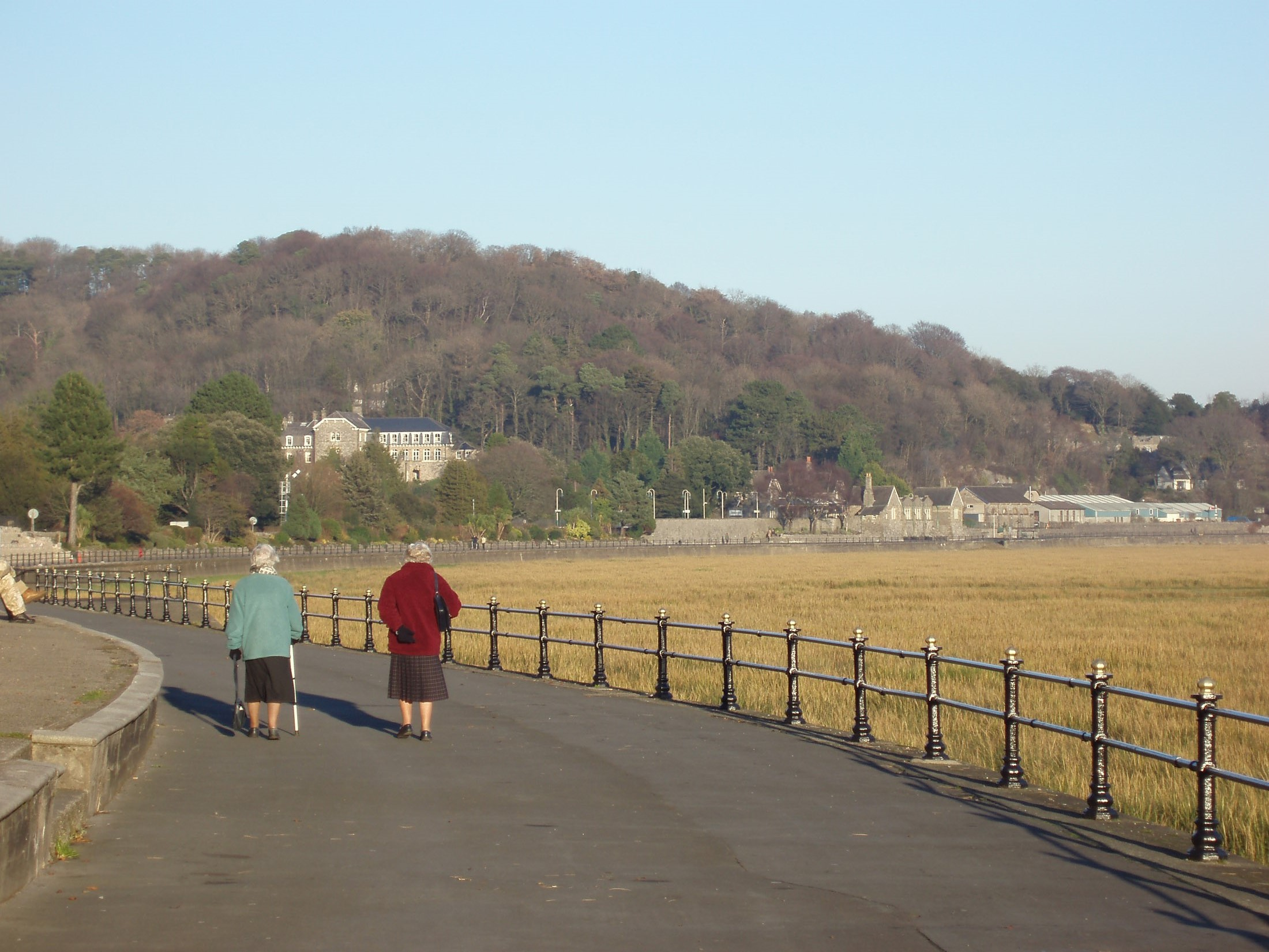 two seniors taking a stroll in grange-over-sands