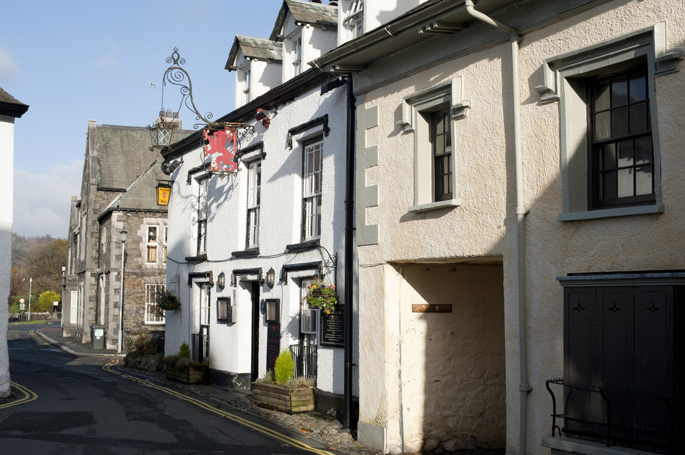 View from the street of the external facade of the Red Lion Inn in the village of Hawkshead in the Lake District in Cumbria