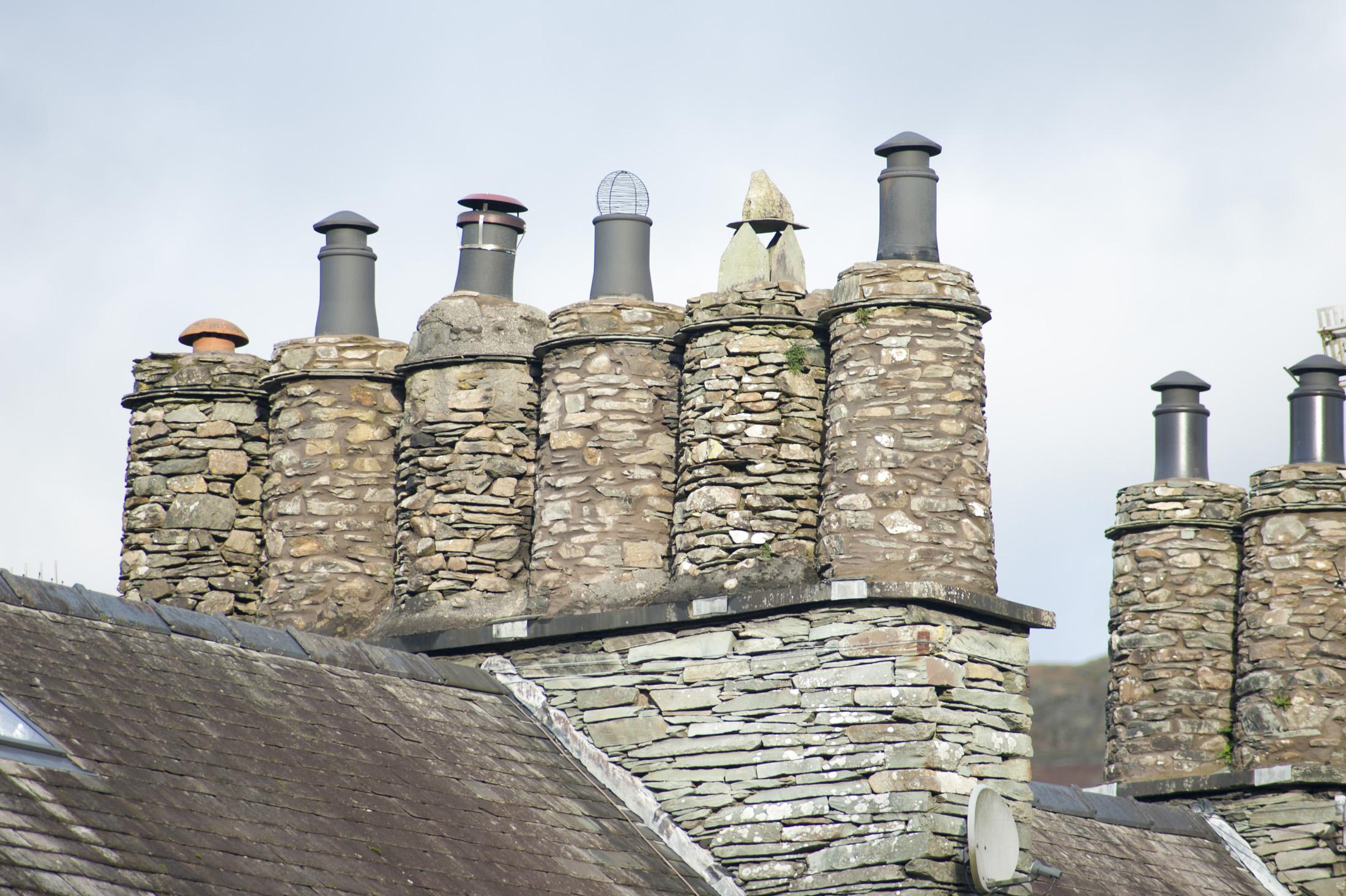 Free stock photo of cylindrical stone chimney pots for Stone chimneys