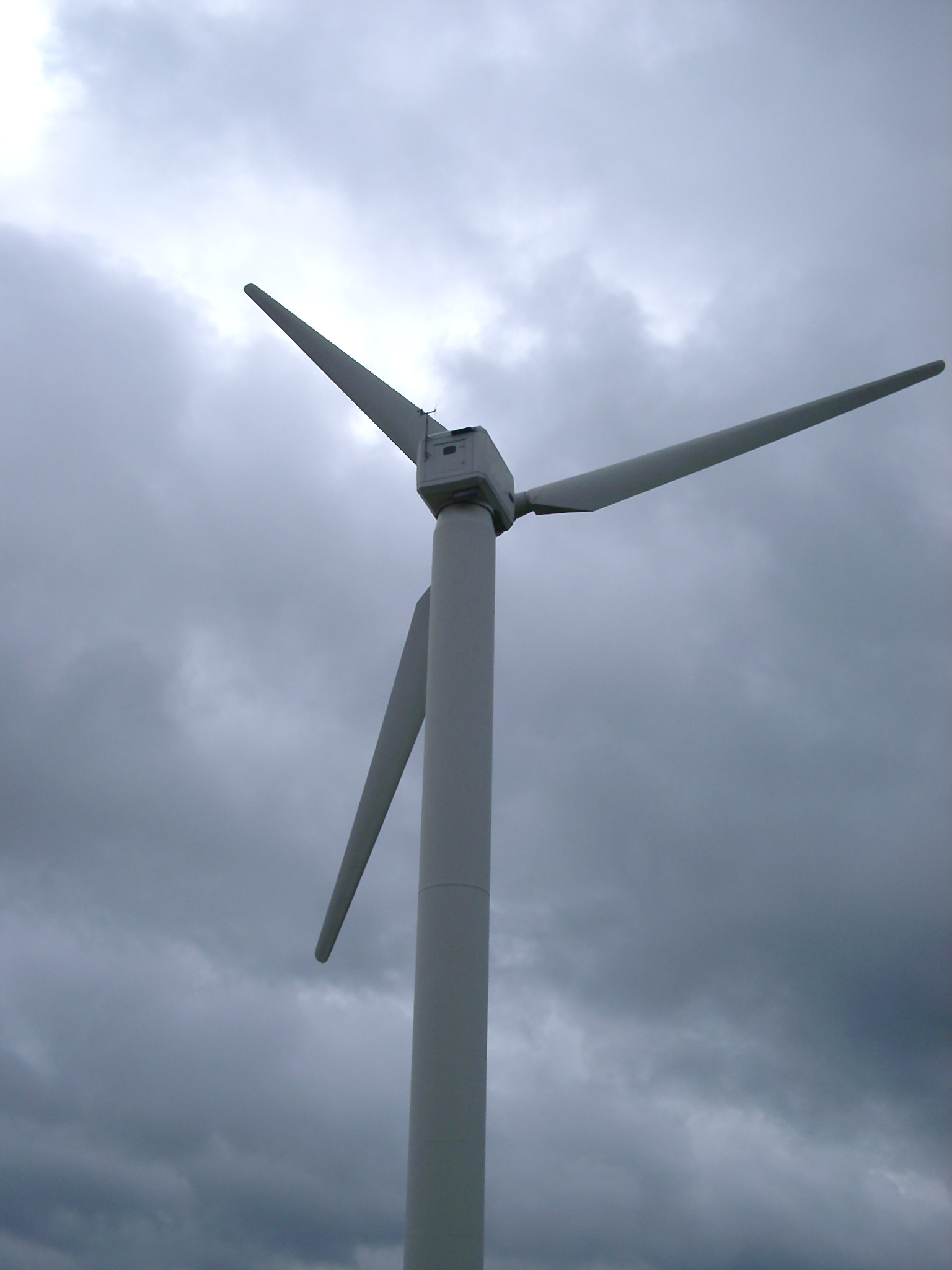 wind turbine against a stormy sky over a cumbiran fell