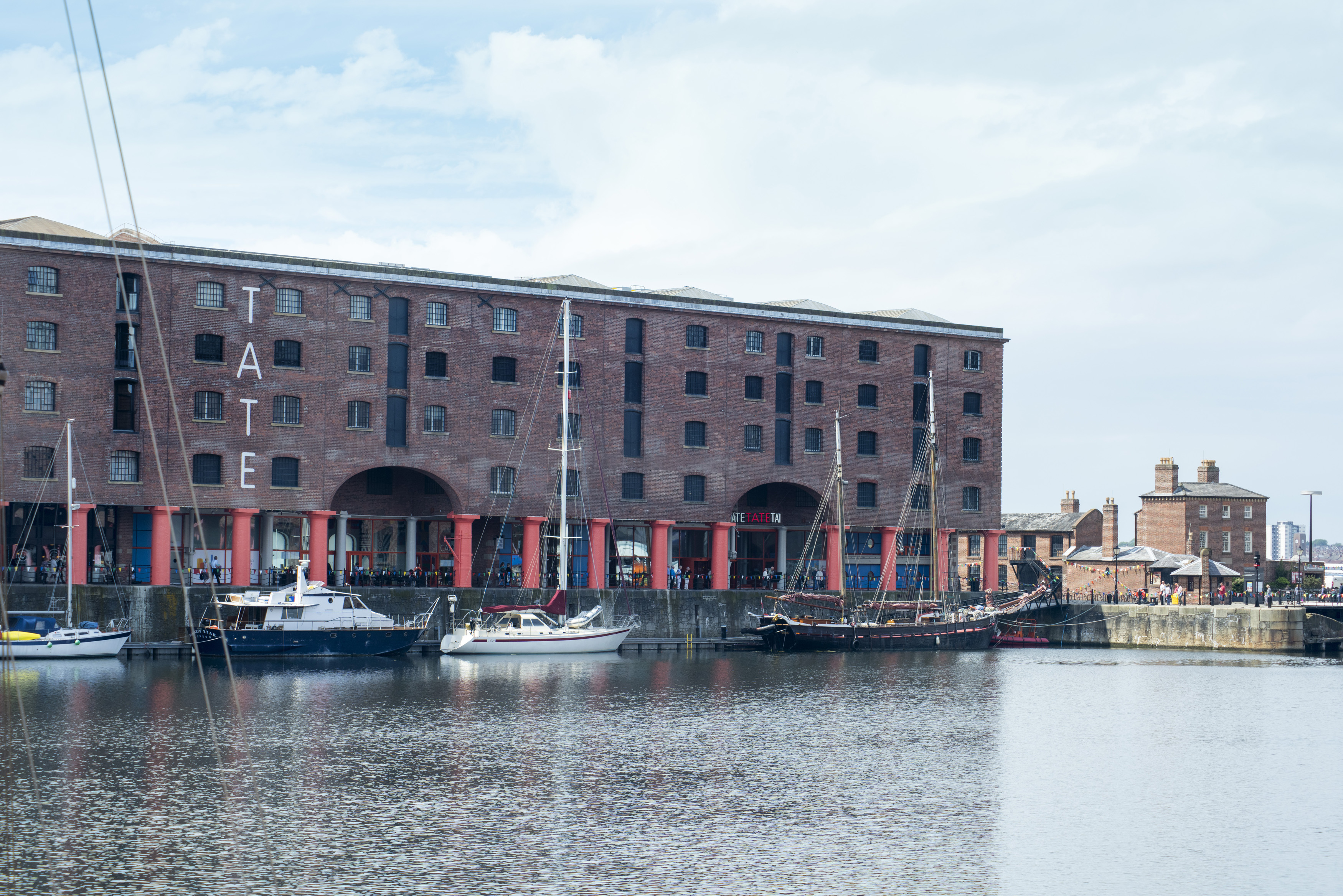 Boats parked near famous landmark tourist destination known as Liverpool Albert Dock in the United Kingdom