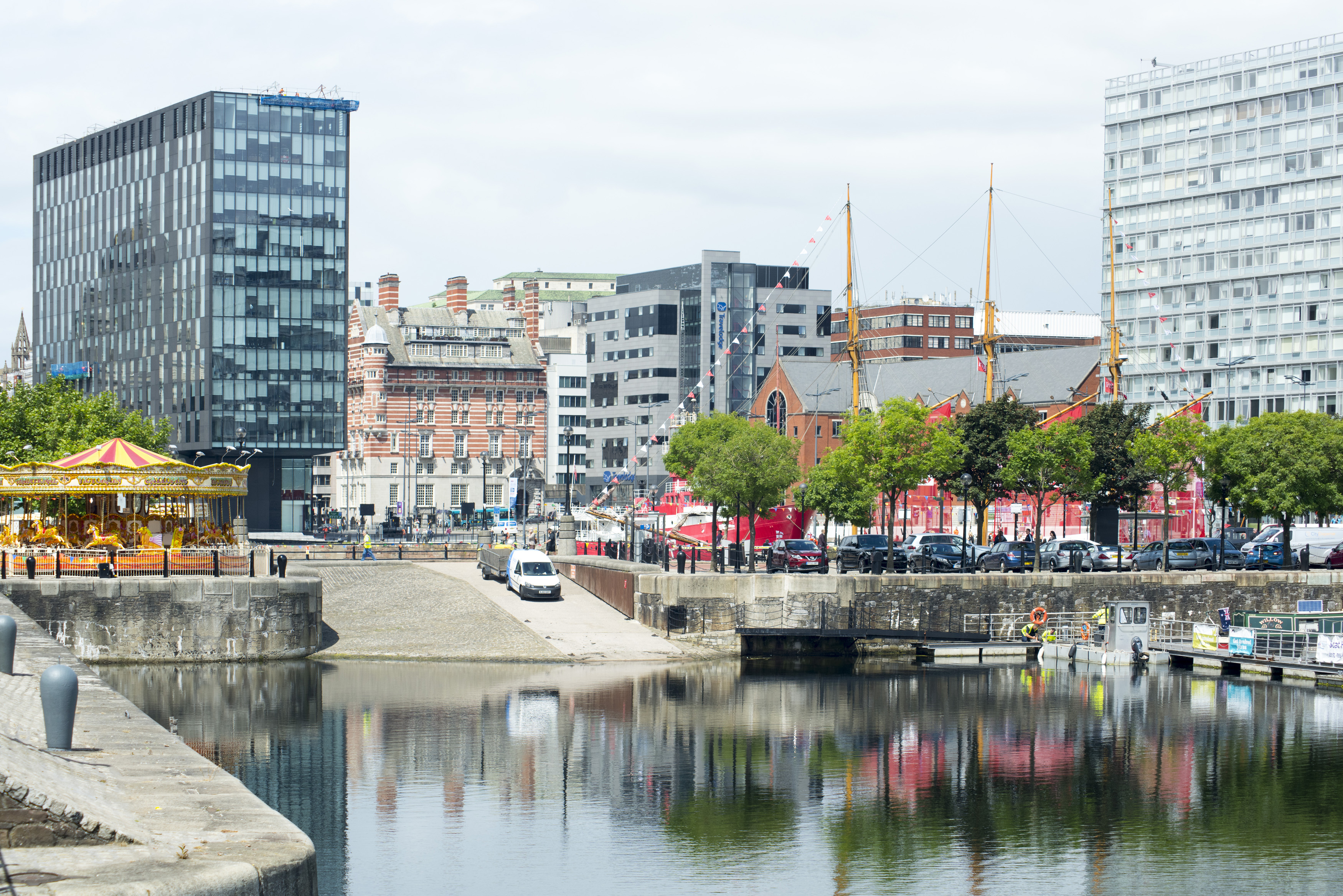 View of merri-go-round and dock on waterfront at Liverpool in the United Kingdom