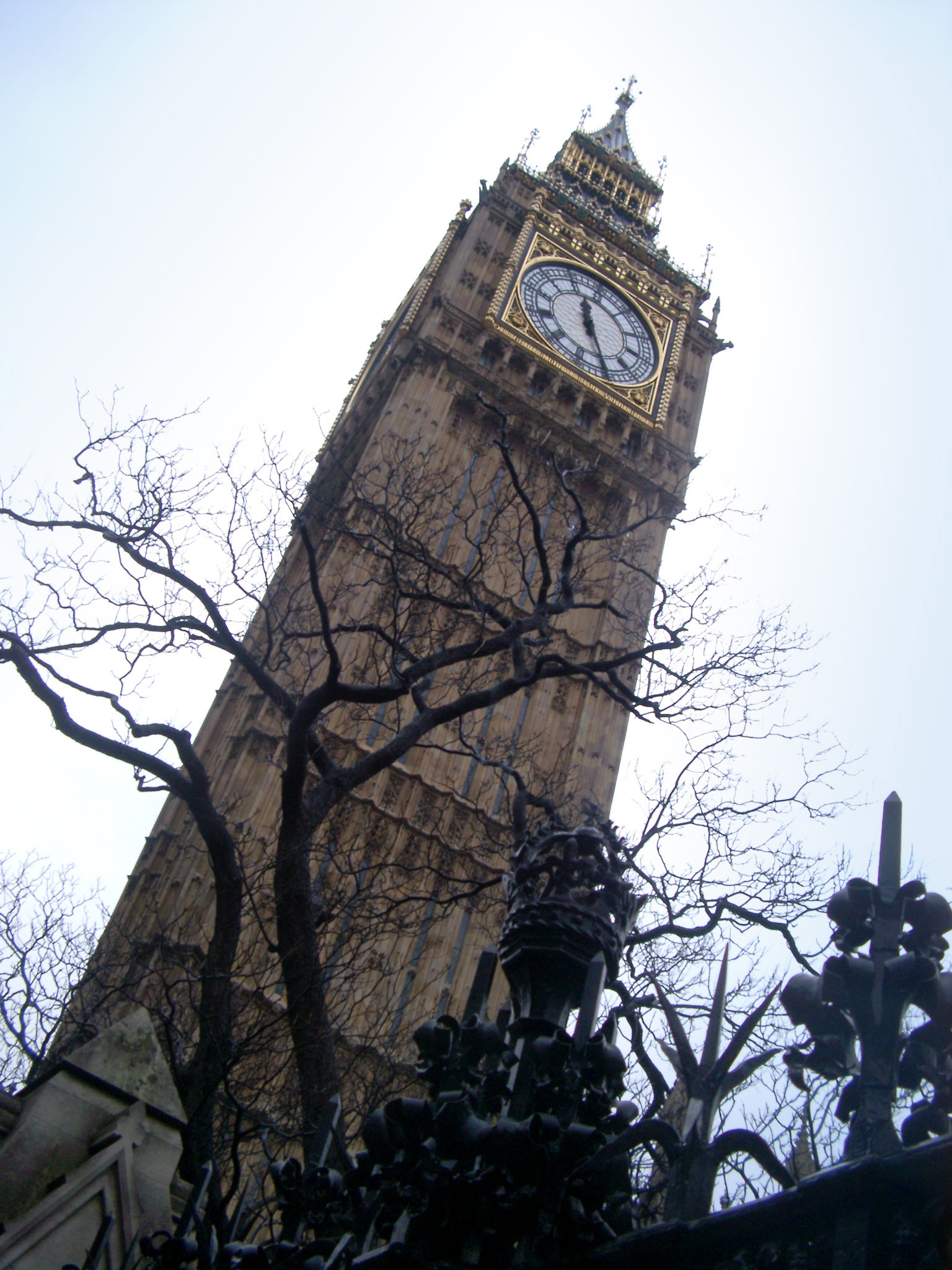 Low angle view looking up the classical Gothic style exterior of the Big Ben clock tower, Westminster, an iconic landmark for London and popular tourist attraction