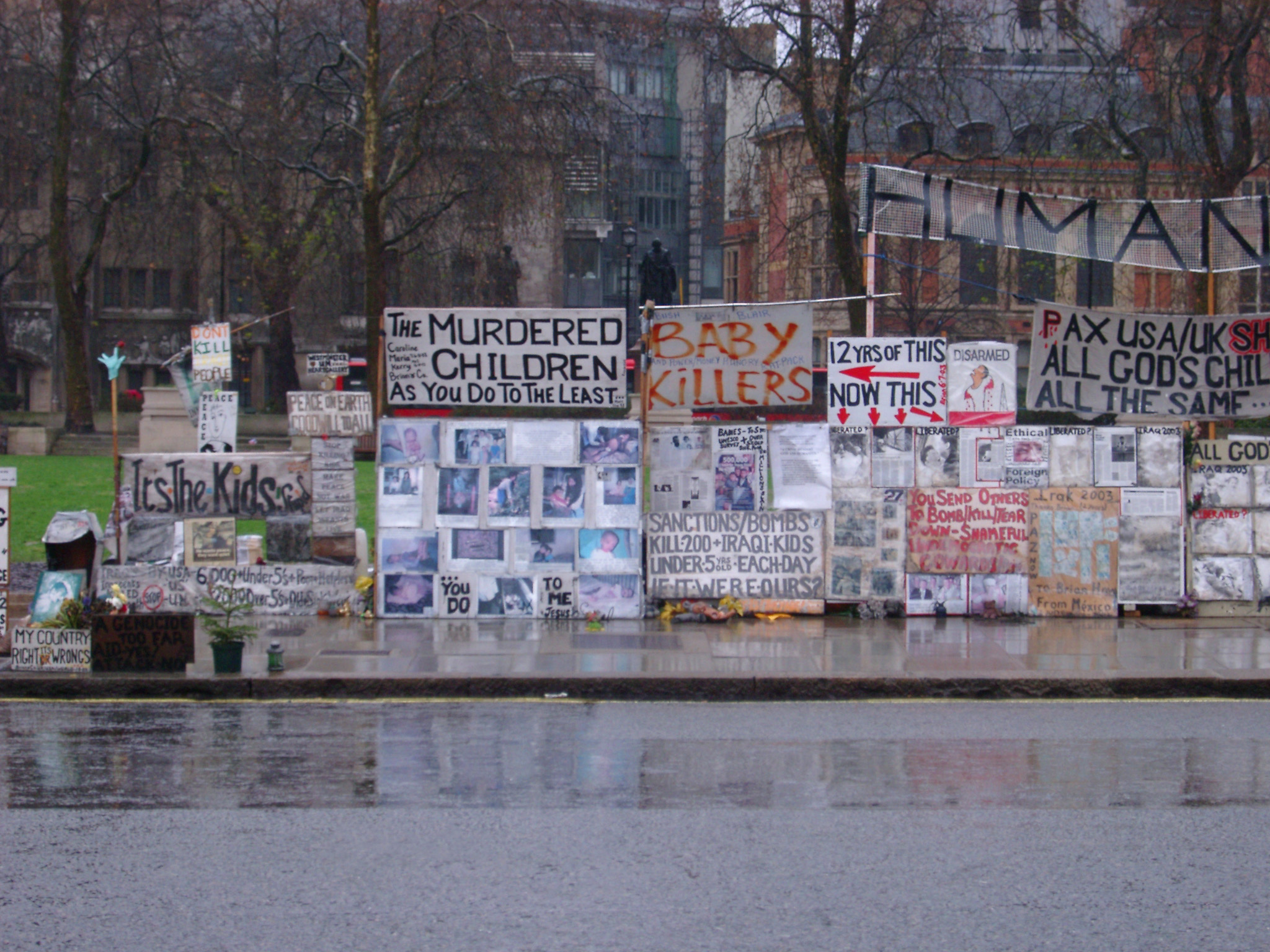 Streetside placards in a demonstration in central London on a wet rainy day