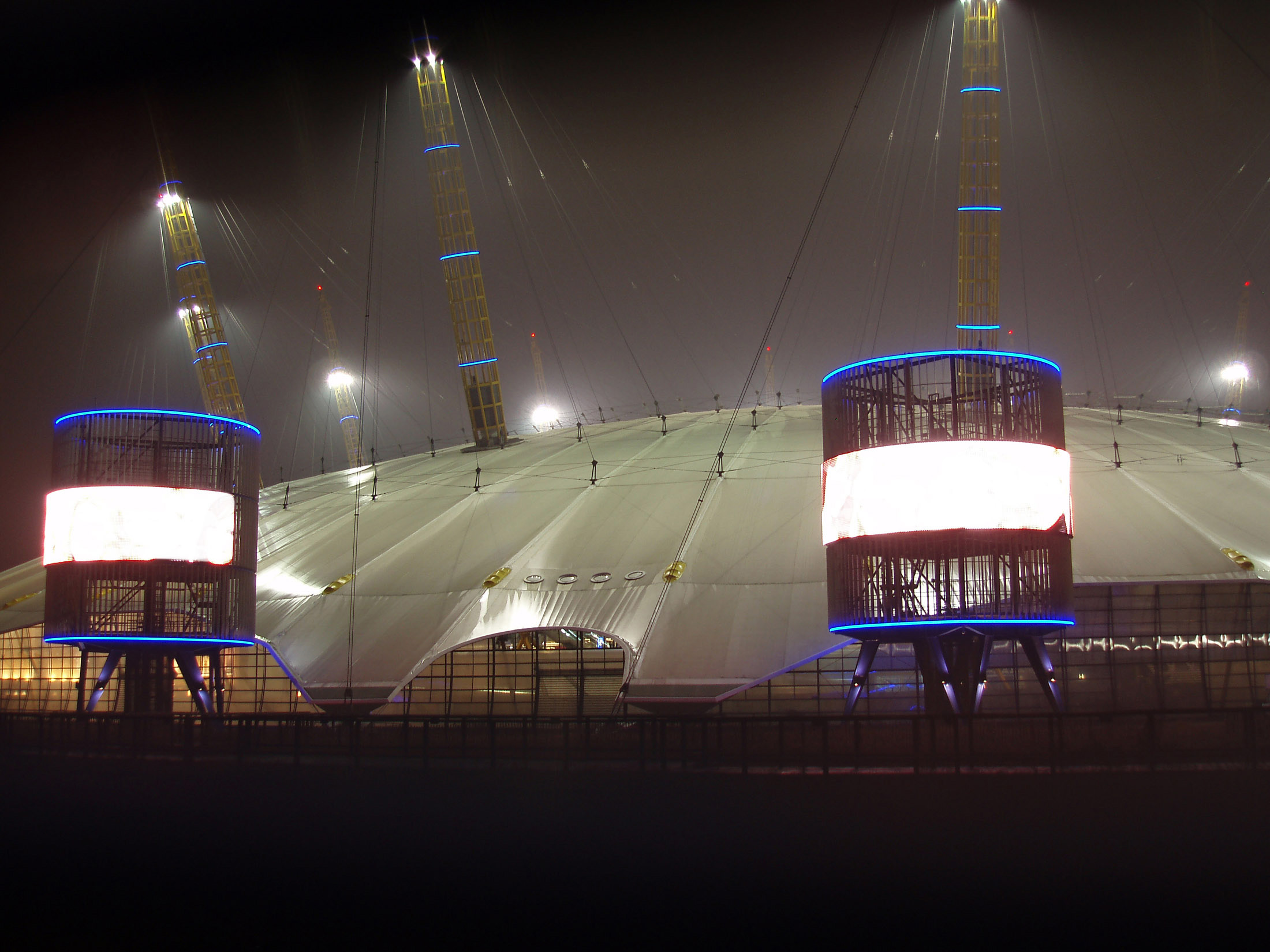 The Millennium Dome or The O2 on the Greenwich peninsula, London is a modern arena and the largest dome originally built to house exhibitions to commemorate the Millennium seen illuminated at night