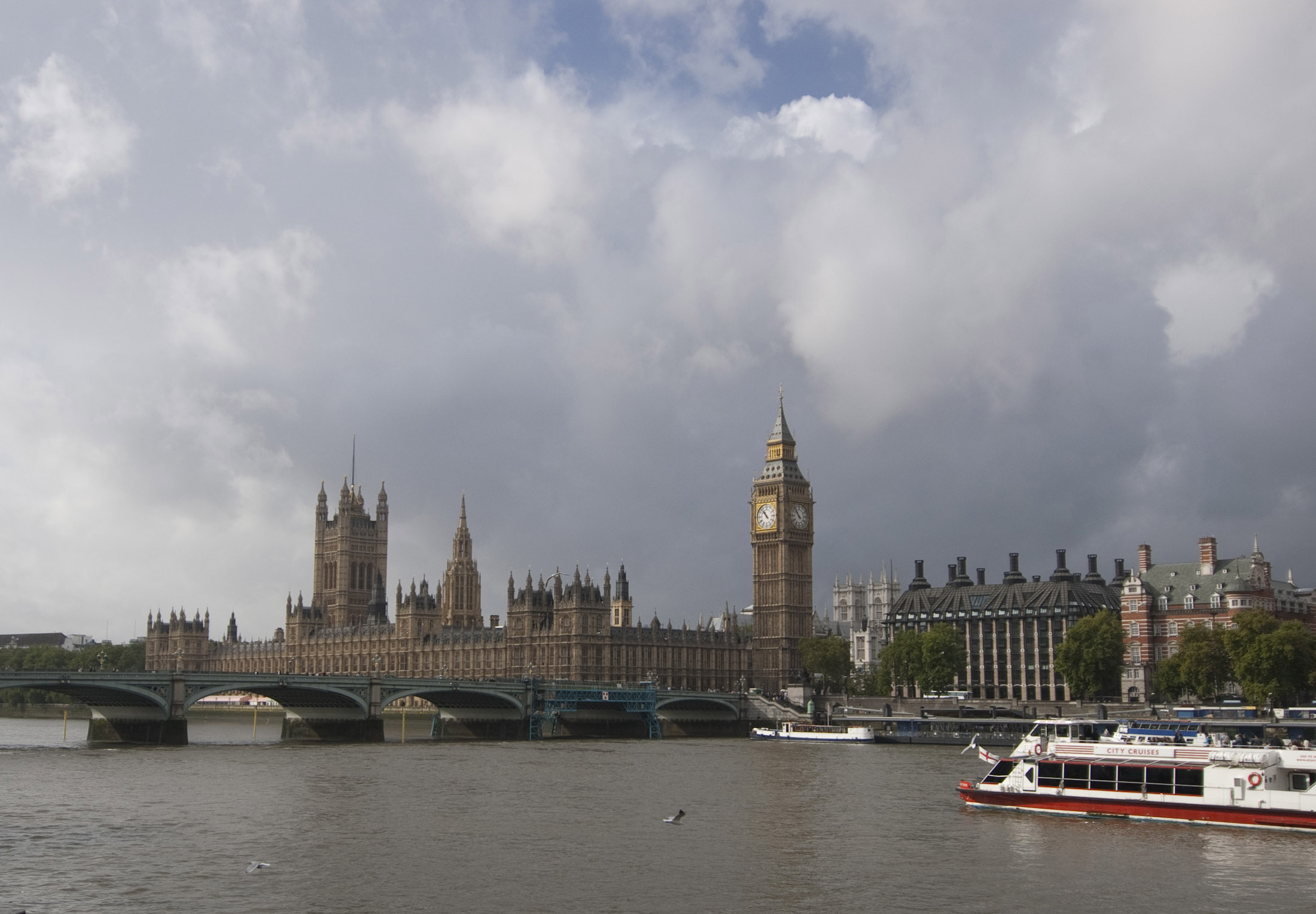 a view of the palace of westminster and big ben clock tower from across the river and westminster bridge
