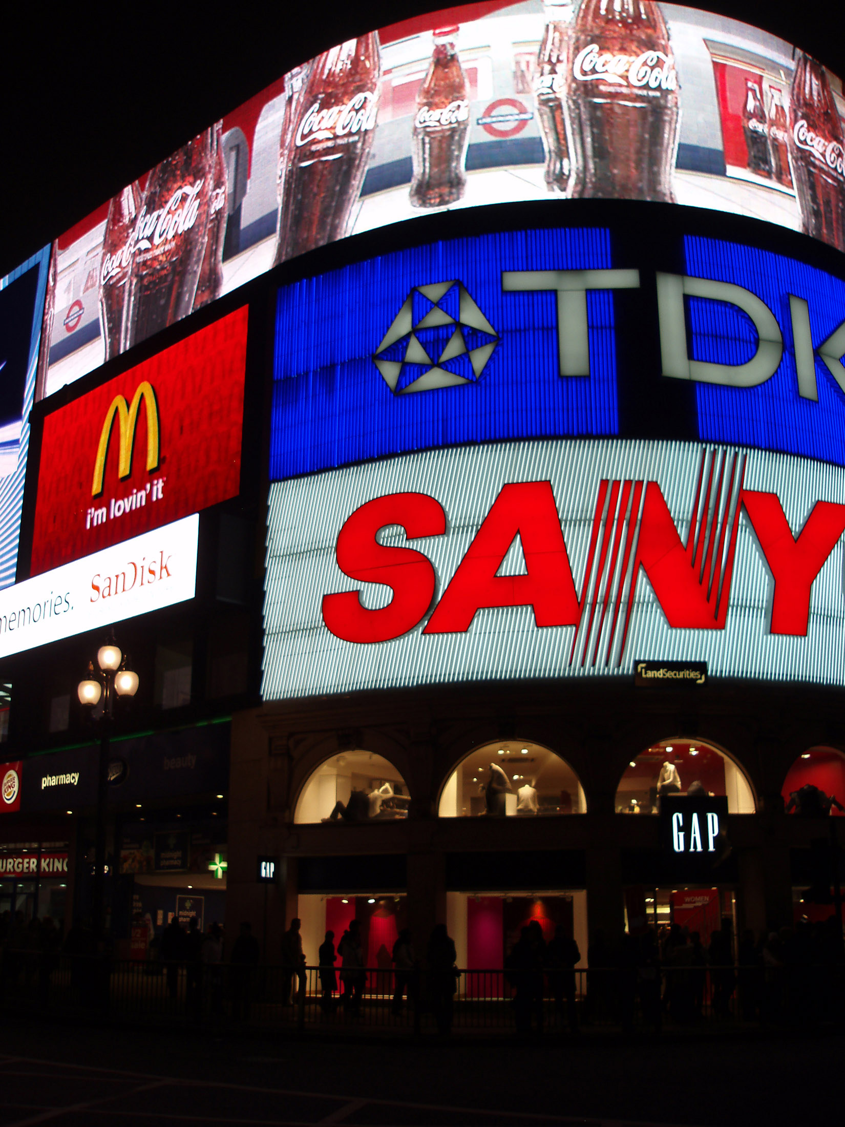 Colorful neon lights and advertising signs at Piccadilly Circus, London illuminated at night
