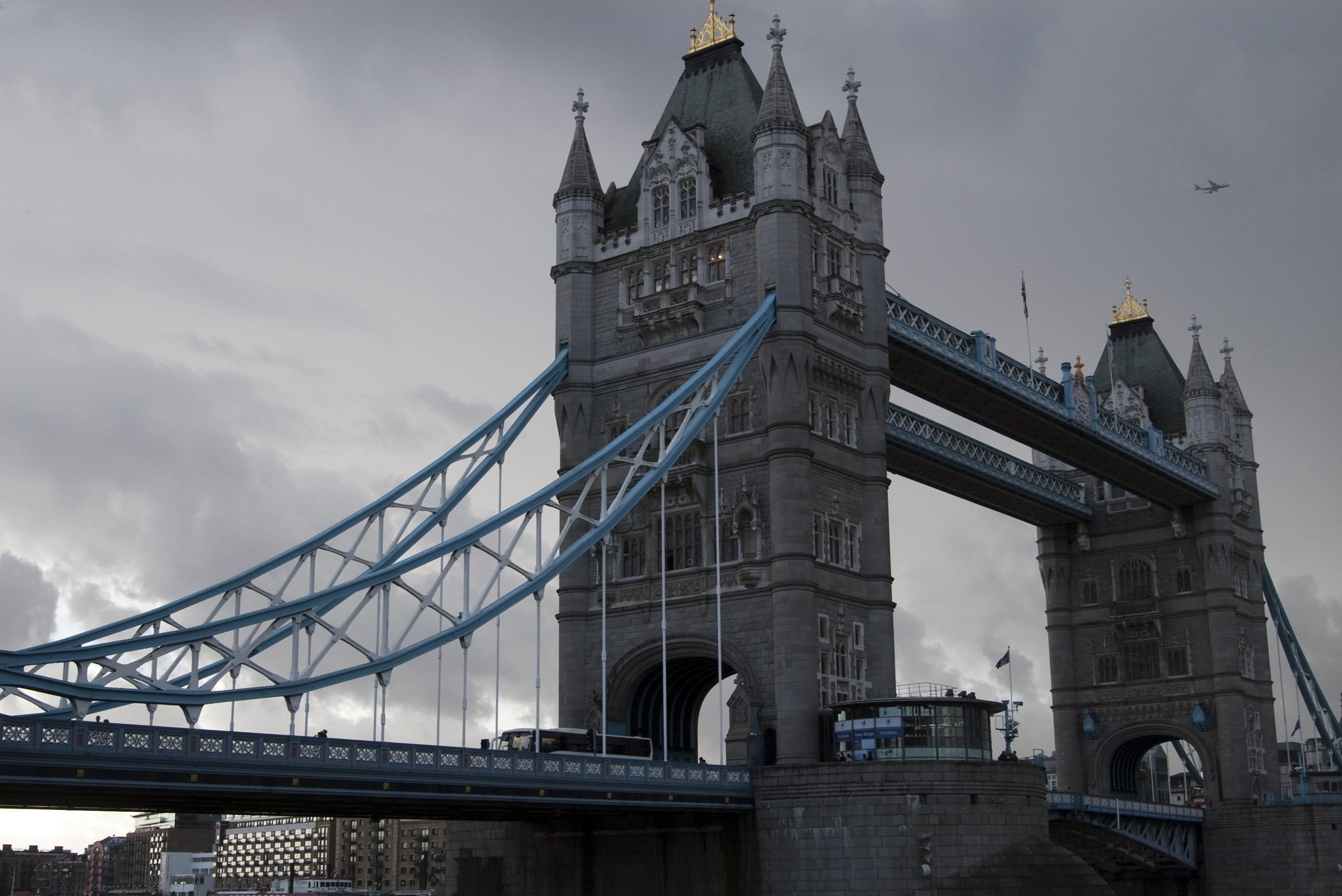 tower bridge crosses the river thames with a suspension and lifting bascule structure