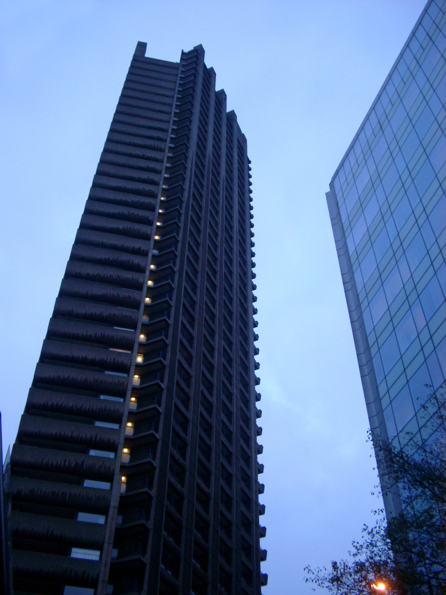 Bruralist Architecture, the Towers of Barbican Estate, a Residential Estate in the City of London. Captured from Lower Angle Point with Light Blue Sky Background.