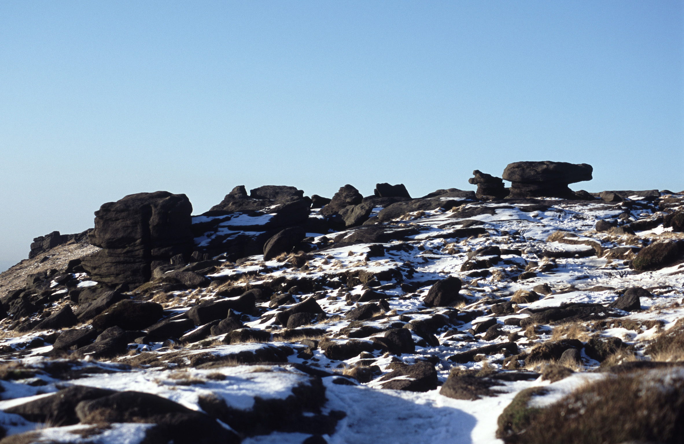 Rocky Landscape in Winter on Sunny Day, Kinder Scout National Nature Reserve, England