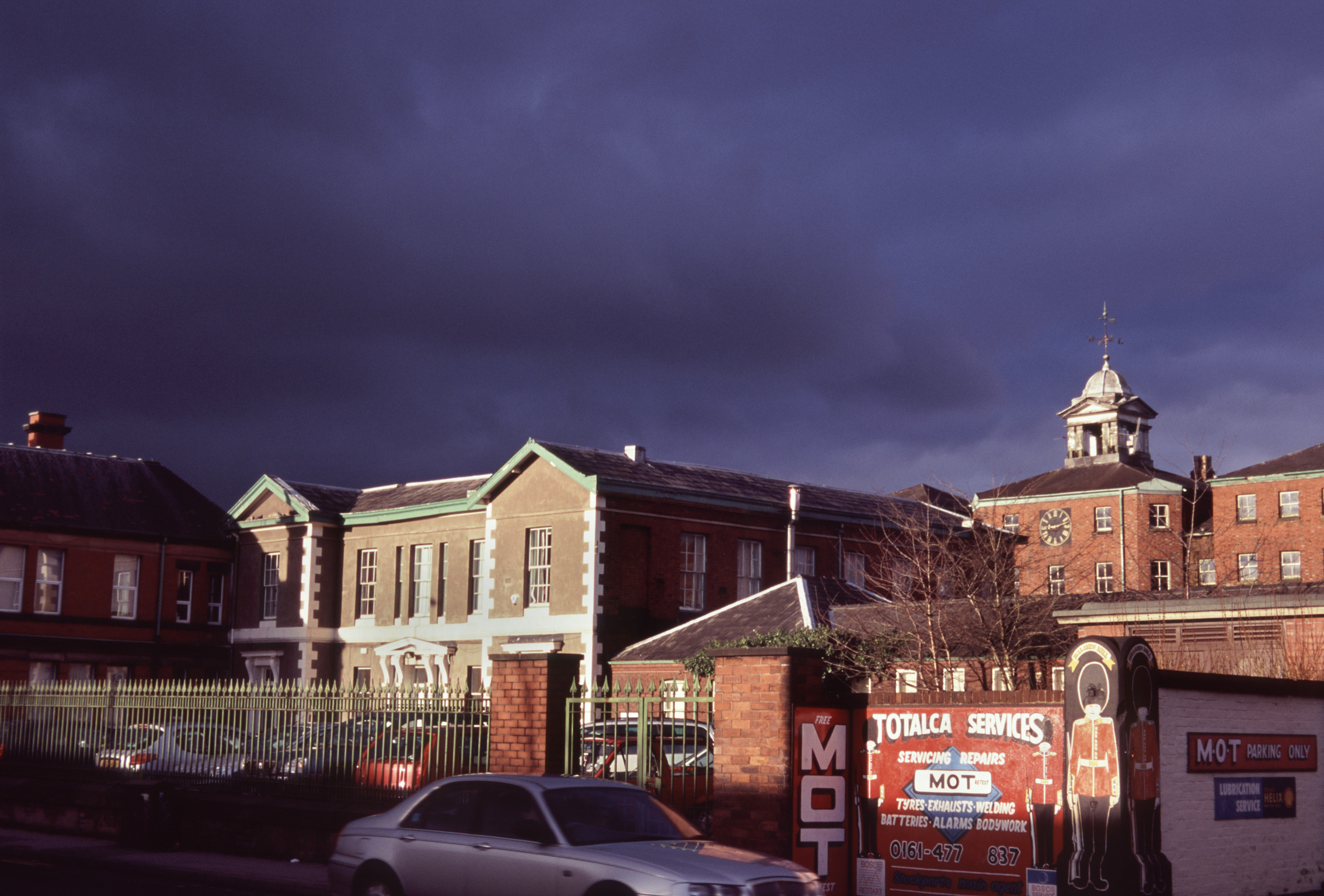 Edgehill Hospital, Stockport on a dark in dramatic lighting on a stormy day with threatening cloud cover