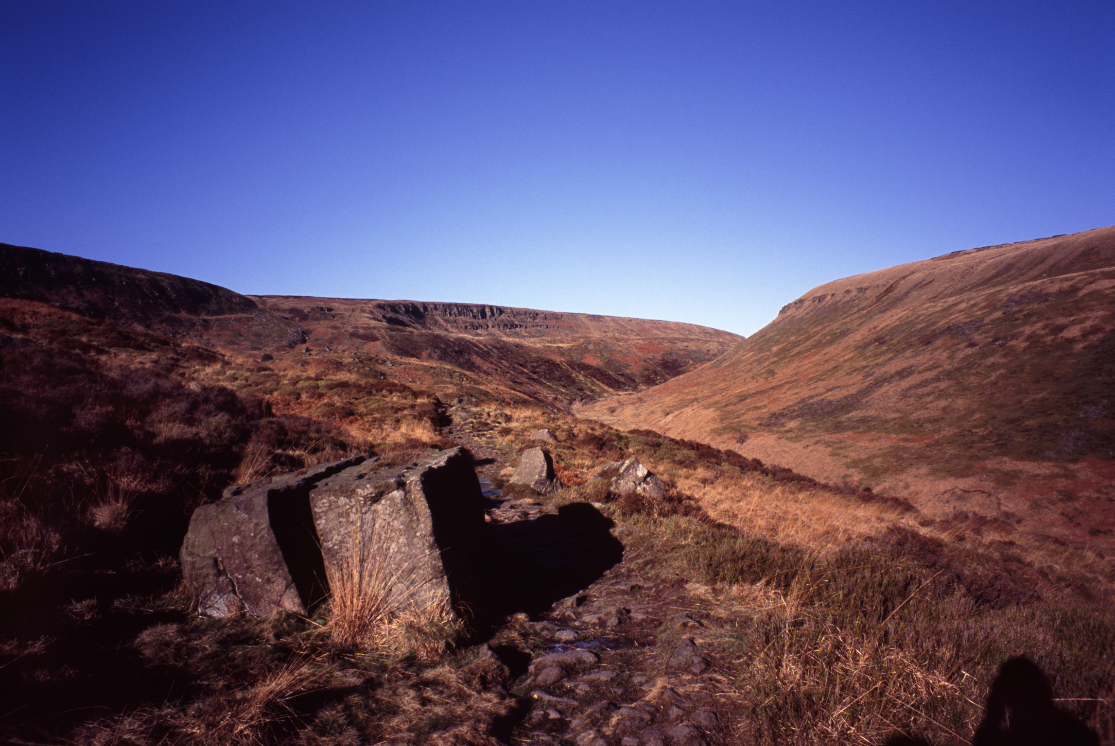 Pennines landscape with grassy moorlands, rocks and hills in North West England