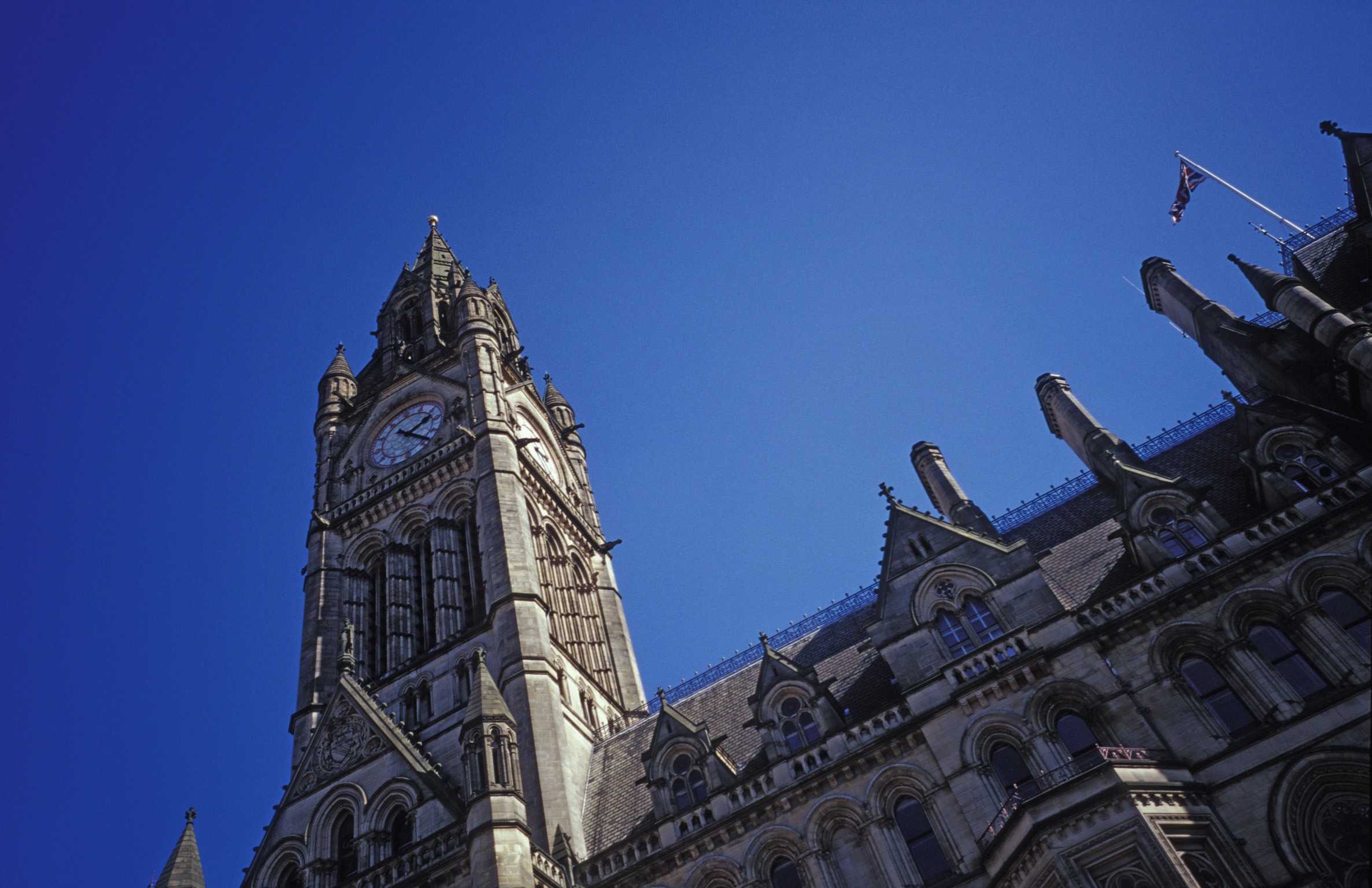 low angle view looking up at the clock tower of manchester town hall