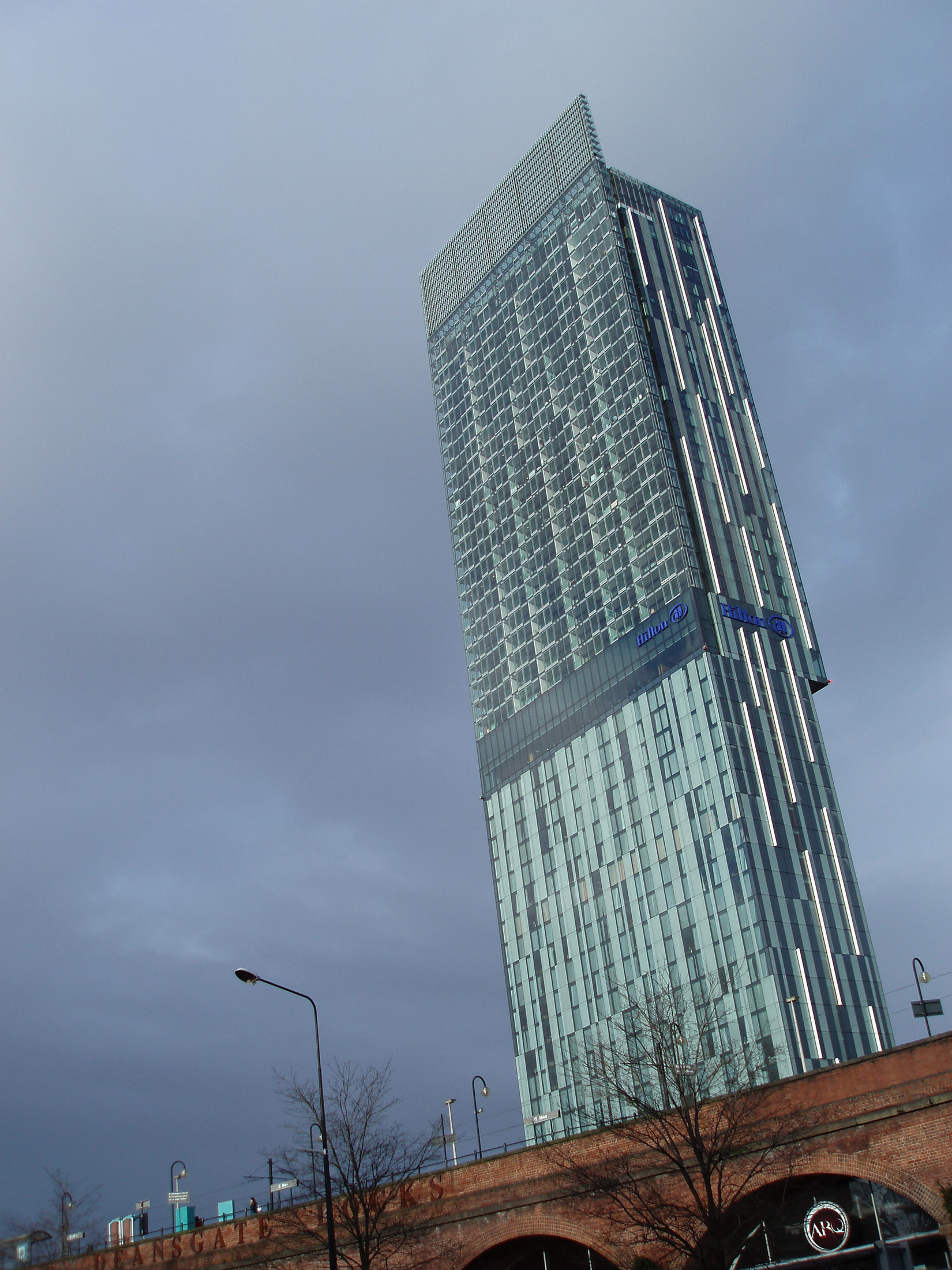Famous Architectural Beetham Tower, also known as Hilton Tower, a 47-storey mixed-use skyscraper in Manchester, England on Gray Sky Background.