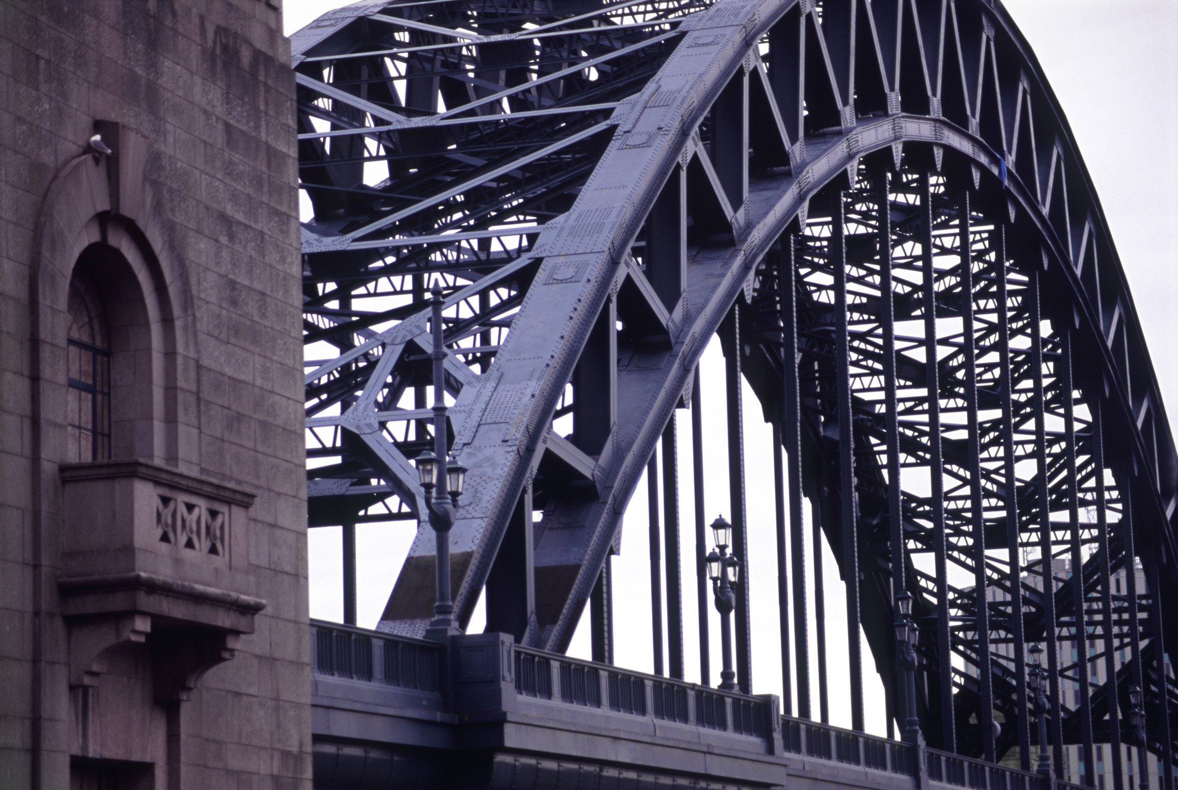 Detail of the steel span and iconic arch on the Tyne Bridge, Newcastle which crosses the River Tyne to connect Gateshead and Newcastle