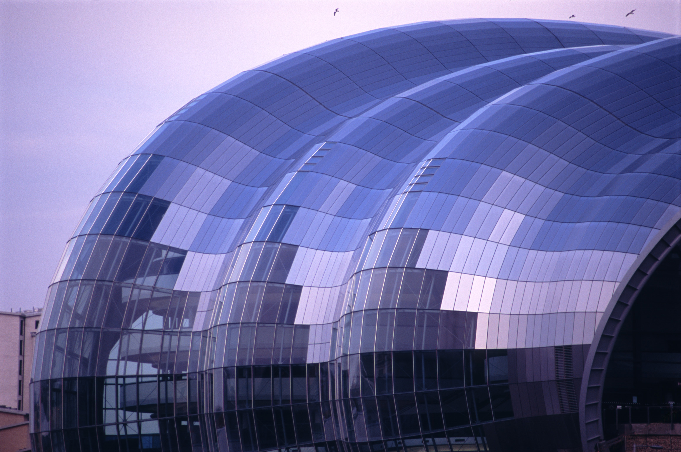 Exterior view of the glass roof covering the sage centre, gateshead