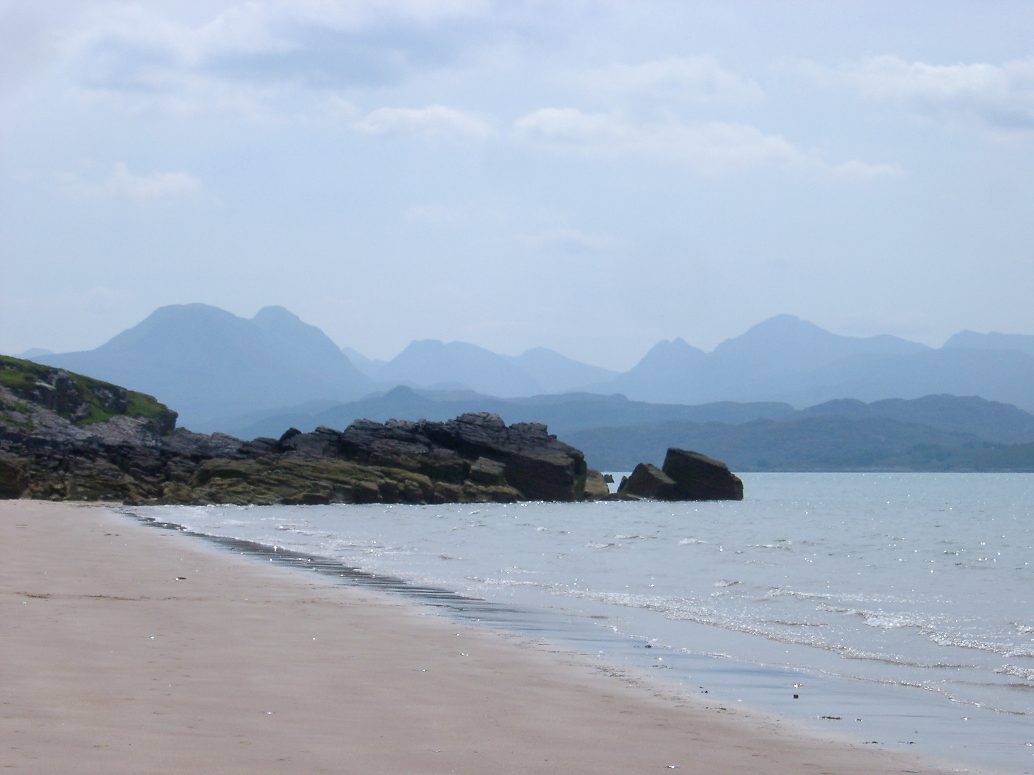Sandy beach on the shores of Loch Gairloch in the North-West highlands of Scotland on a misty day