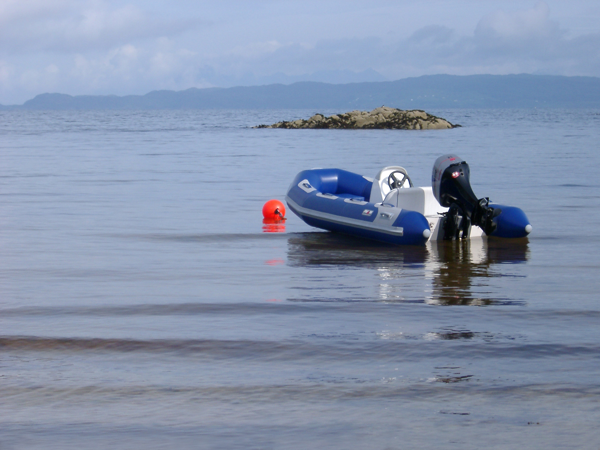 Small Blue Motorboat for Leisure Activity Resting on the Beautiful Sea at Scotland