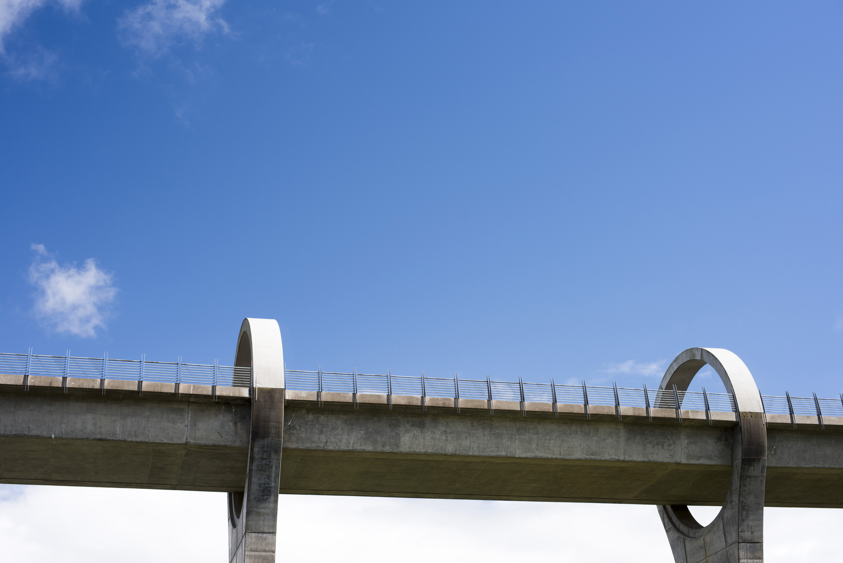 Viaduct for Falkirk Wheel Boat lift structure under blue sky with scattered white clouds in Scotland