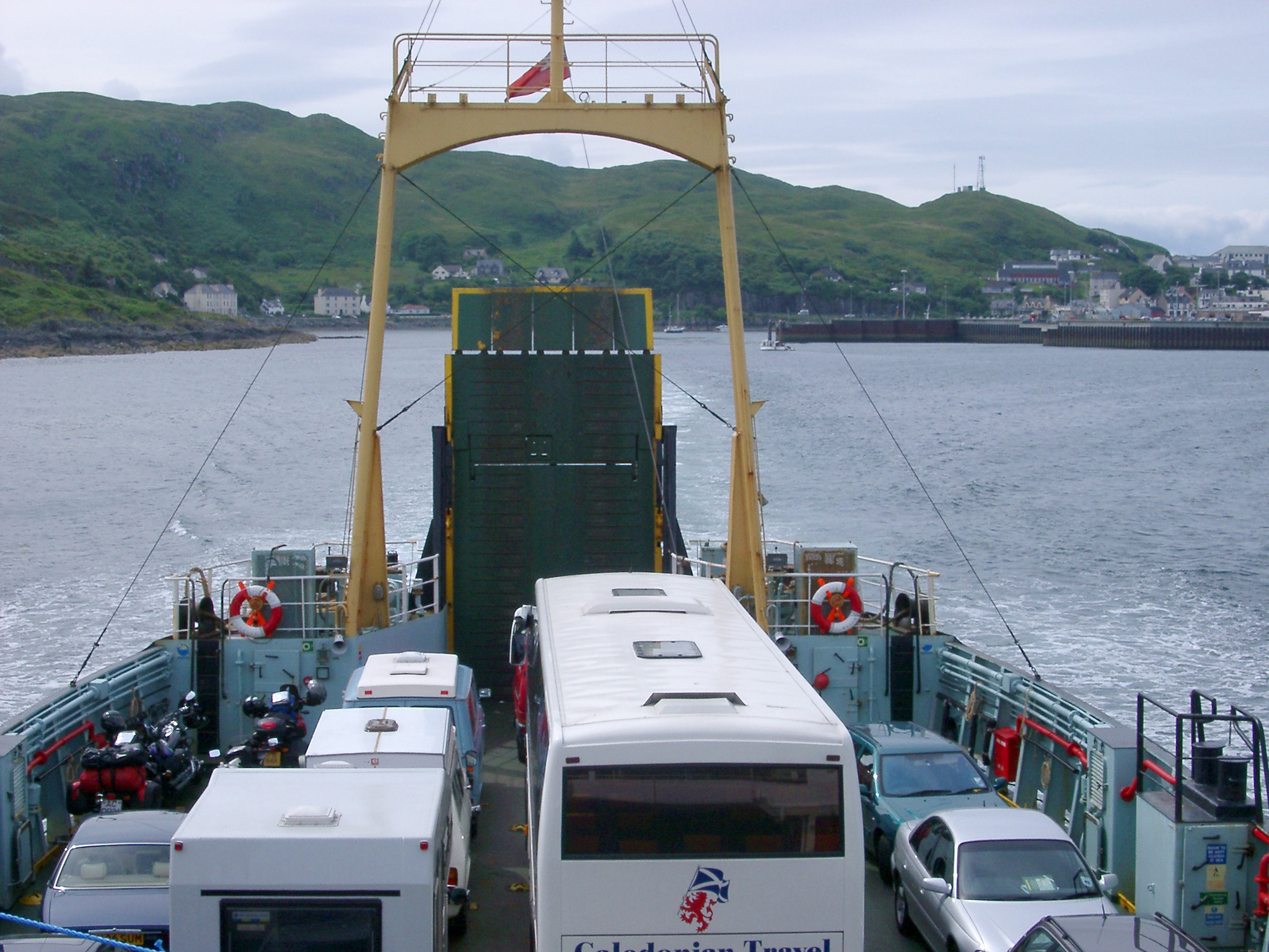 View over the roofs of the cars and bus parked on the deck of the Maillag to Skye ferry as it crosses the straits